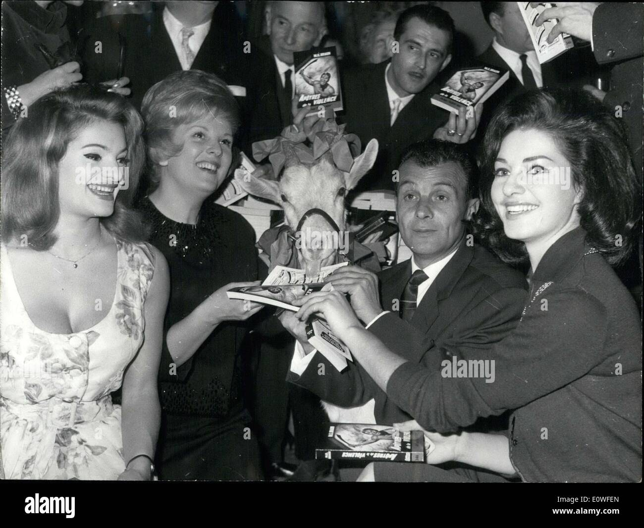 Oct. 26, 1962 - The Golden Palms of spy novels of 1962 was given to Maurice Gabriel Braun for his book ''Apostles of Violence''. He is pictured here surrounded by Sylvia Sorente, Catherine Langeais, and Monique Lemaire (Miss France 1962) - Stock Image