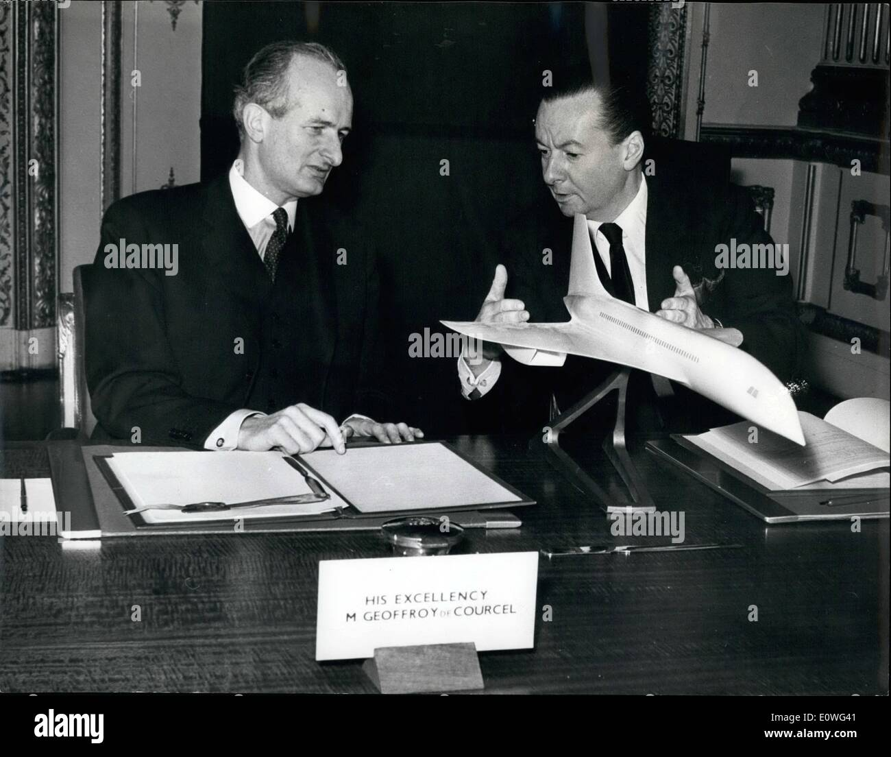Nov. 11, 1962 - Angelo-French supersonic airliner agreement signed: Mr Julian Amery (right), the Minister of Aviation and M. Geoffroy de Courcel, the french Ambassador in London, look in a model of a proposed supersonic airliner in Lancaster house, London, today, after they signed am Angelo-French agreement fir the joint development of a supersonic airliner. Each country has agreed to spend between ?75 and ?85 million for development and tooling of production lines. - Stock Image