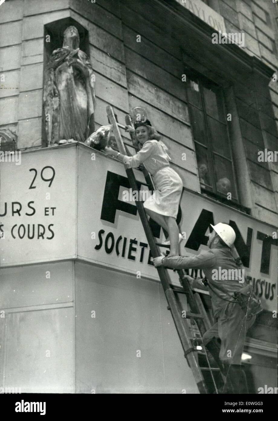 Nov. 23, 1962 - Claude Blondy Adorns St. Catherine Statue with Flowers - Stock Image