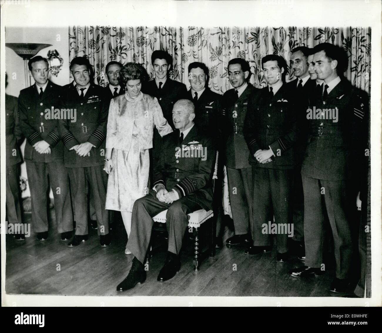 Jan. 01, 1963 - King of Greece tanks British airmen for saving life of young mother. King Paul and Queen Frederika of Greece recently gave a reception at the Tatoi Royal Palace for a number of British airmen who took part in a rescue operation to save the life of a young mother. The woman, who lived on the small island of Kastellorizo was in urgent need of blood and an operation after giving birth to a child. Rough weather made the approach to the island by sea impossible to the Greek authorities flashed an SOS to Cyprus - Stock Image