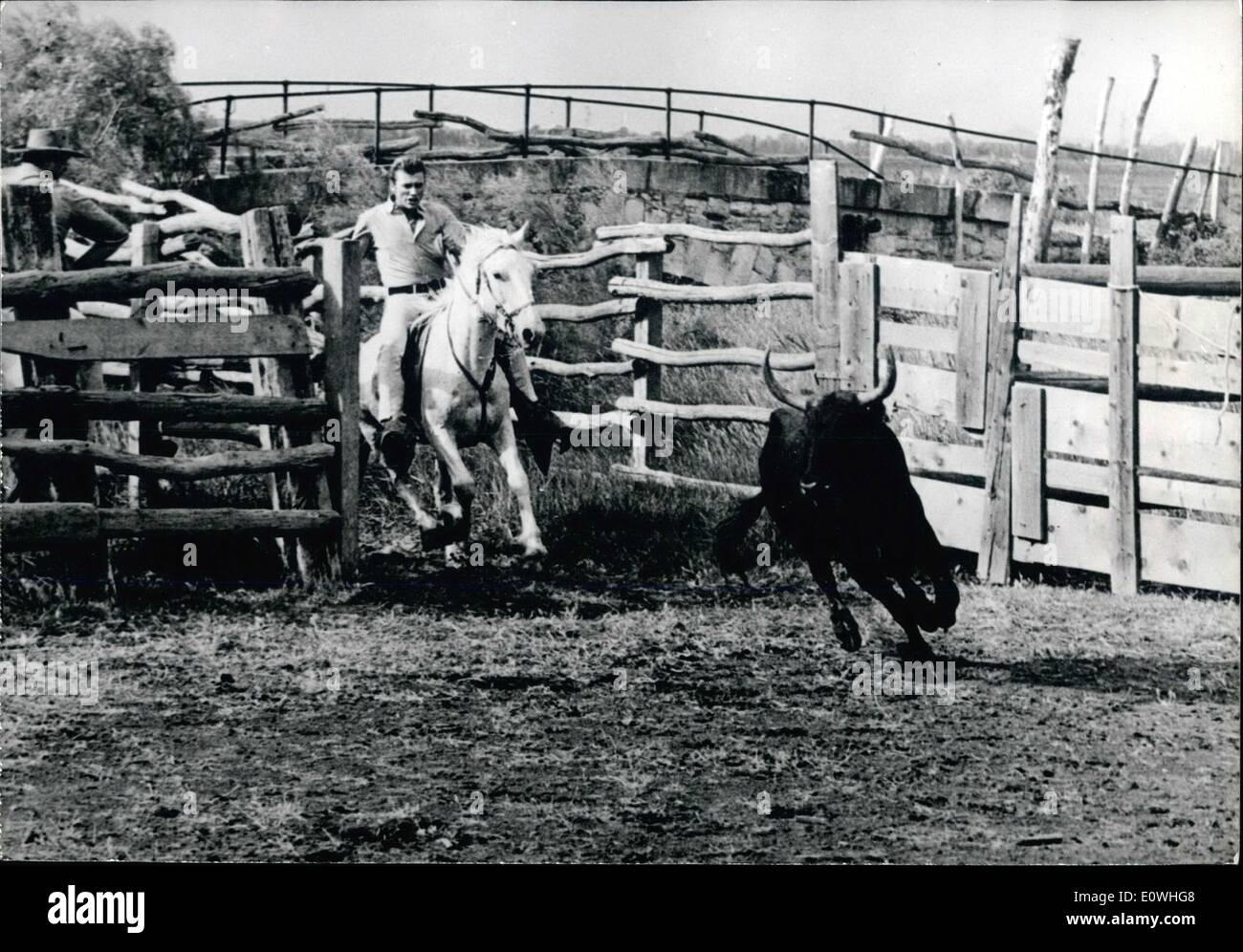 Feb. 02, 1963 - The ''Gardian'' Johnny Hallyday ... In Cam argue, between the pond of Vaccares and the Pet it-Rhone France's number one twister is shooting his first picture a ''Western'' under the direction of Noel Howard with the title : ''D'ou viens-tu Johnny ?'' The Story of a twist-singer falling in the hands of some dangerous gangsters.. Photo Shows Gordian costumed Johnny Hallyday pursues a bull. - Stock Image