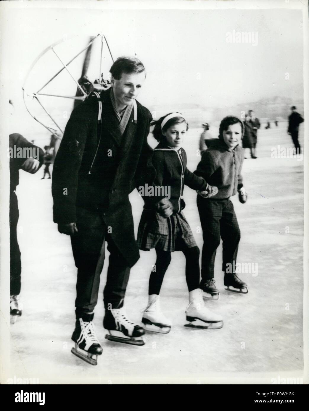 Feb. 02, 1963 - They Call Him - ''The Lazy Skater''... Automatic Propulsion - Over The Ice - In Zurich: Many eyebrows were lifted in surprise when this skater went on to the ice - on a frozen lake in Zurich - a few days ago - with on his back - his own invention - which he calls the ''Miniprop''.. It is like an enclosed propeller which propels him over the ice at something like 20 m.p.h. - Stock Image