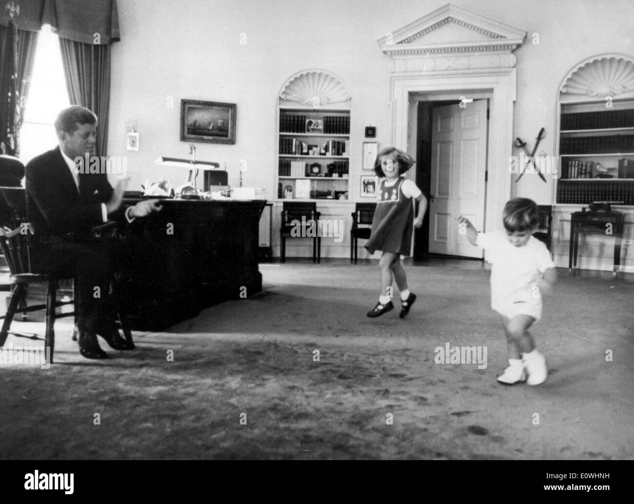 President Kennedy playing with his kids in the White House - Stock Image