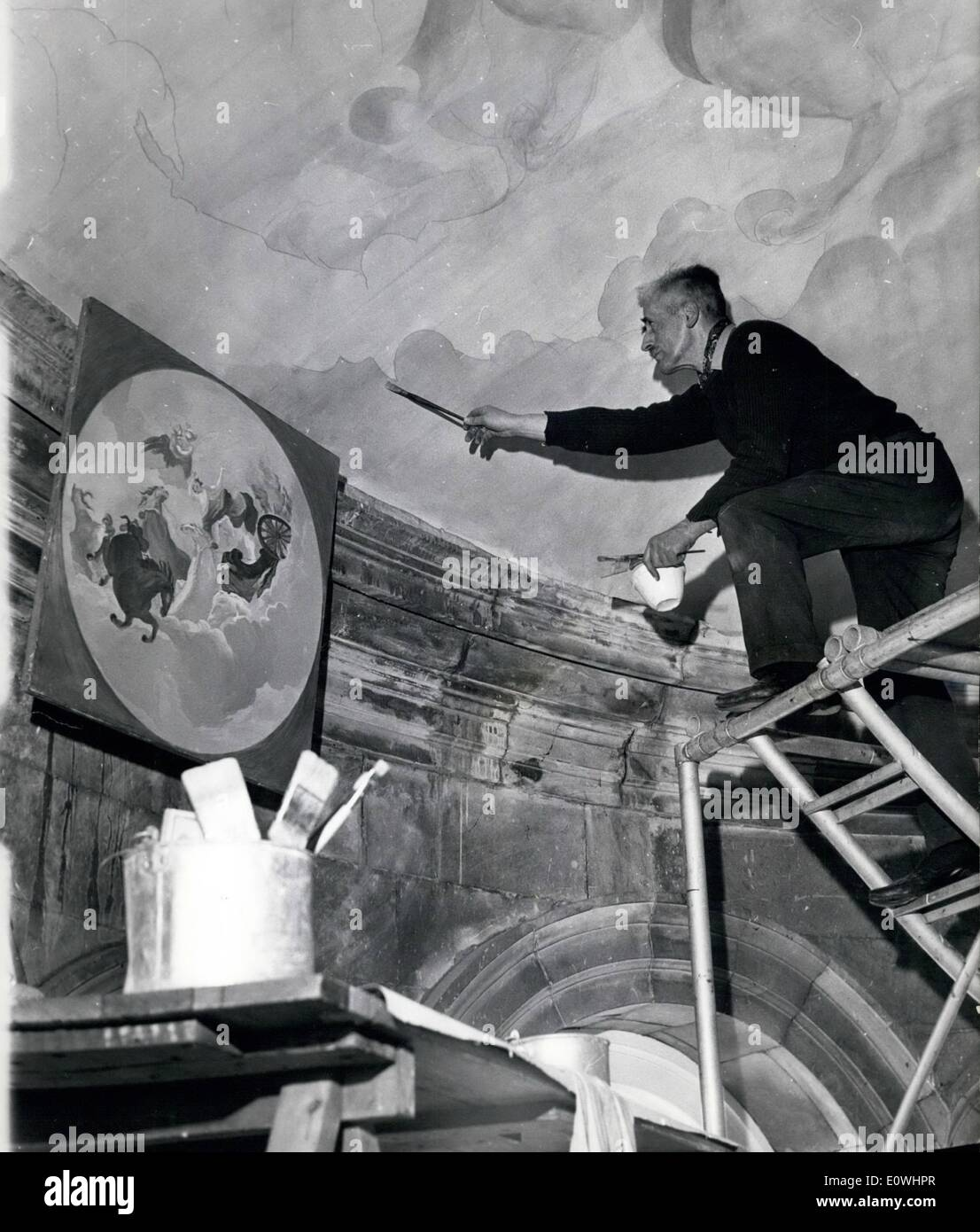 May 05, 1963 - Artist with a head for heights.: 51 year old Canadian artist Scott Ackerman Medd, who is art director of the British School in Rome. is painting a mural 80ft above the entrance hall to Castle Howard, one of Yorkshire's stately homes. He is protected by a safety net specially constructed by a shop rig-gin company. The mural is from Italian masterix Antonio Pellegrini's ''The all of Phaeton'', and replaces the original mural which was destroyed by fore 23 years ago. Photo shows Mr. Medd at work on his mural. - Stock Image
