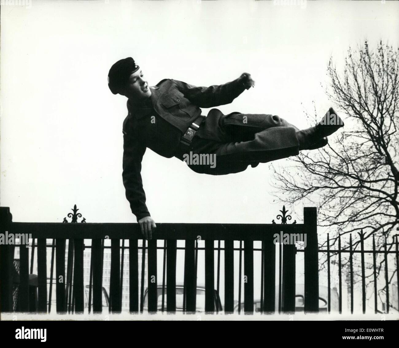 Feb. 02, 1963 - The army wanted to demo ''Orphan Joe'' - But he proves he is fit - to soldier on. Seventeen year old Joe Hardisty who was told that he was medically unfit for Army service - jumped for joy yesterday. He leaped from a 12 ft. concrete block outside the Tate gallery in London after passing a tough three hour medical examination at the nearby Millbank hospital. Seven weeks ago - Private Joe - an orphan was told he would have to be discharged because of a minor ches ailment.. Because he was so keen - his - C.O. appealed to the top Army bass for Joe to be given another medical - Stock Image