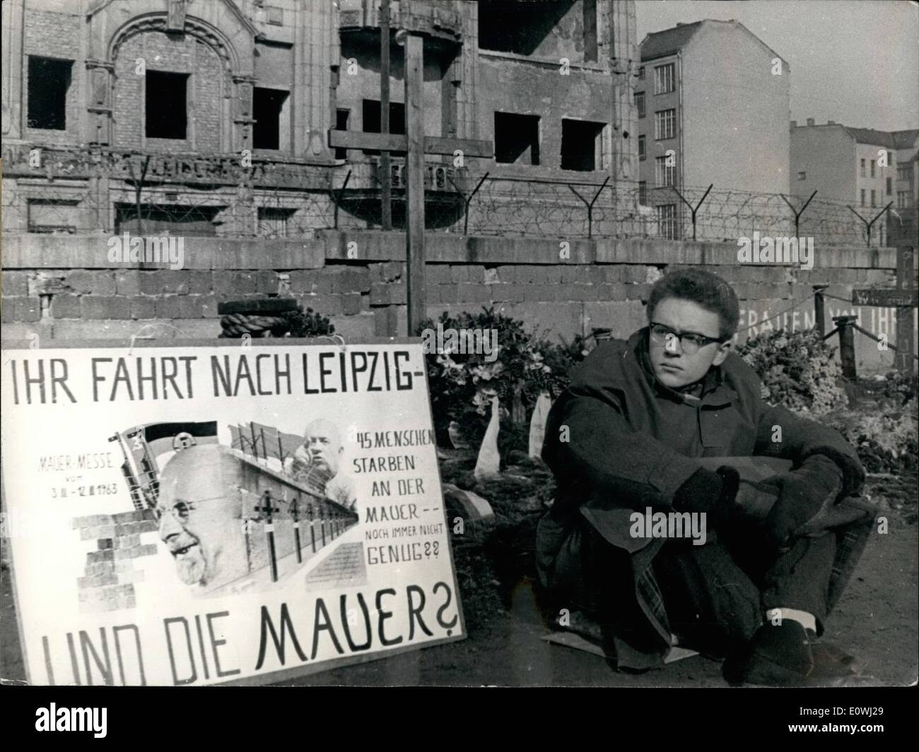 Mar. 03, 1963 - A 19 years old Westberliner wants to consider the West-German and other western business men. He protested against the businessmen which are driving to Leipzig to the East zone exhibition, never theless the wall. He will sit for three days on the memorial for the shooting Eastberliner Peter Fechter. ~~~~ his place he was a placard with the words 50 Your are going to the Leipzig Fair and what about the wall?'' 45 people died at the wall - Not En~~gh. Stock Photo