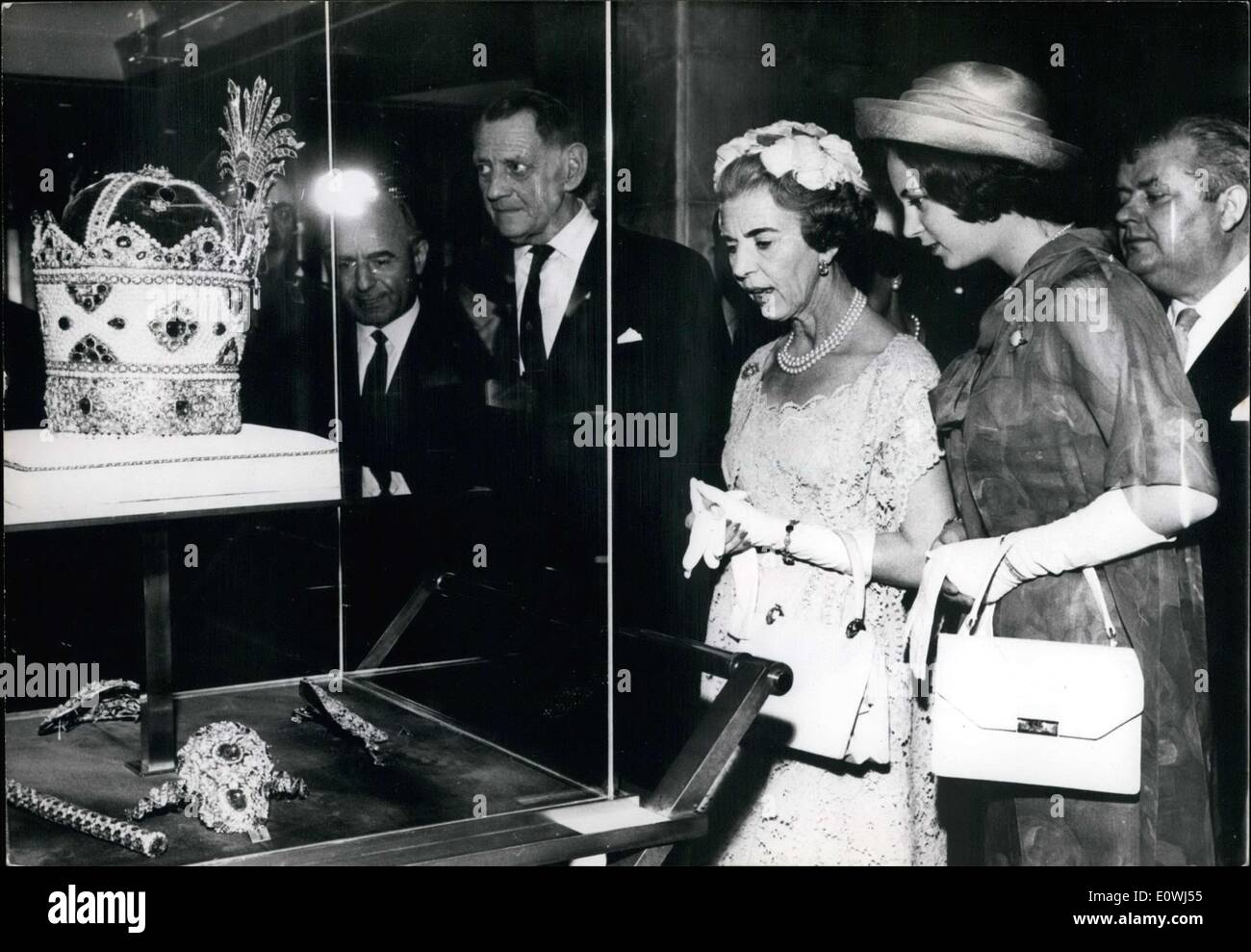 May 08, 1963 - Denmark's King Frederik, Queen Ingrid, and Princess Benedikte are seen here looking at the imperial jewels of Iran during their visit with the Shah and Empress of Iran. - Stock Image