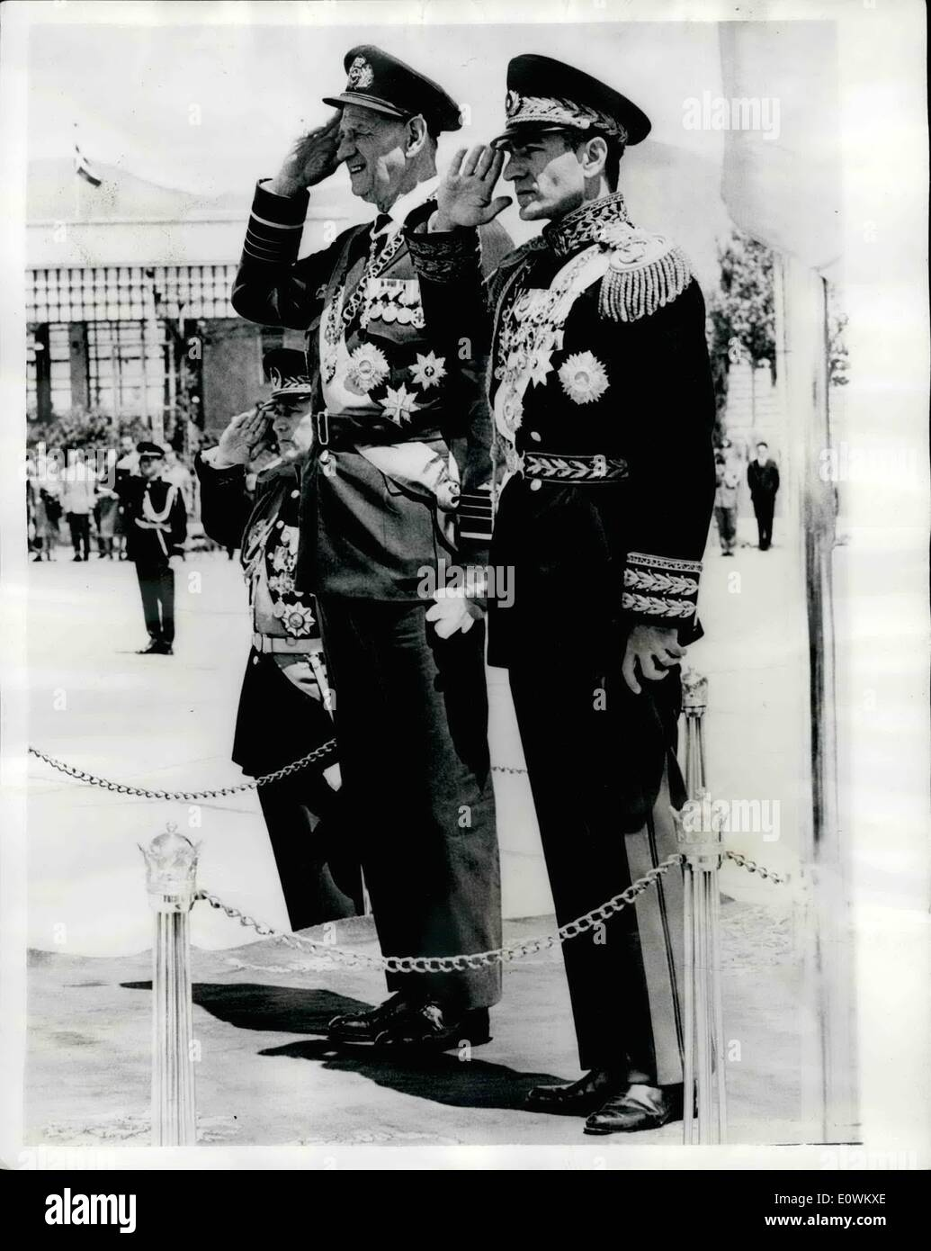 May 05, 1963 - Danish Royal family visit Iran.: The King and Queen of Denmark and their daughter princess Benedikte are on an official visit to Iran. They were welcomed on their arrival at Teheran by the Shahansa and Empress. Photo shows King Frederick (left) and the Shah salute the guard of Honour at Teheran Airport - Stock Image