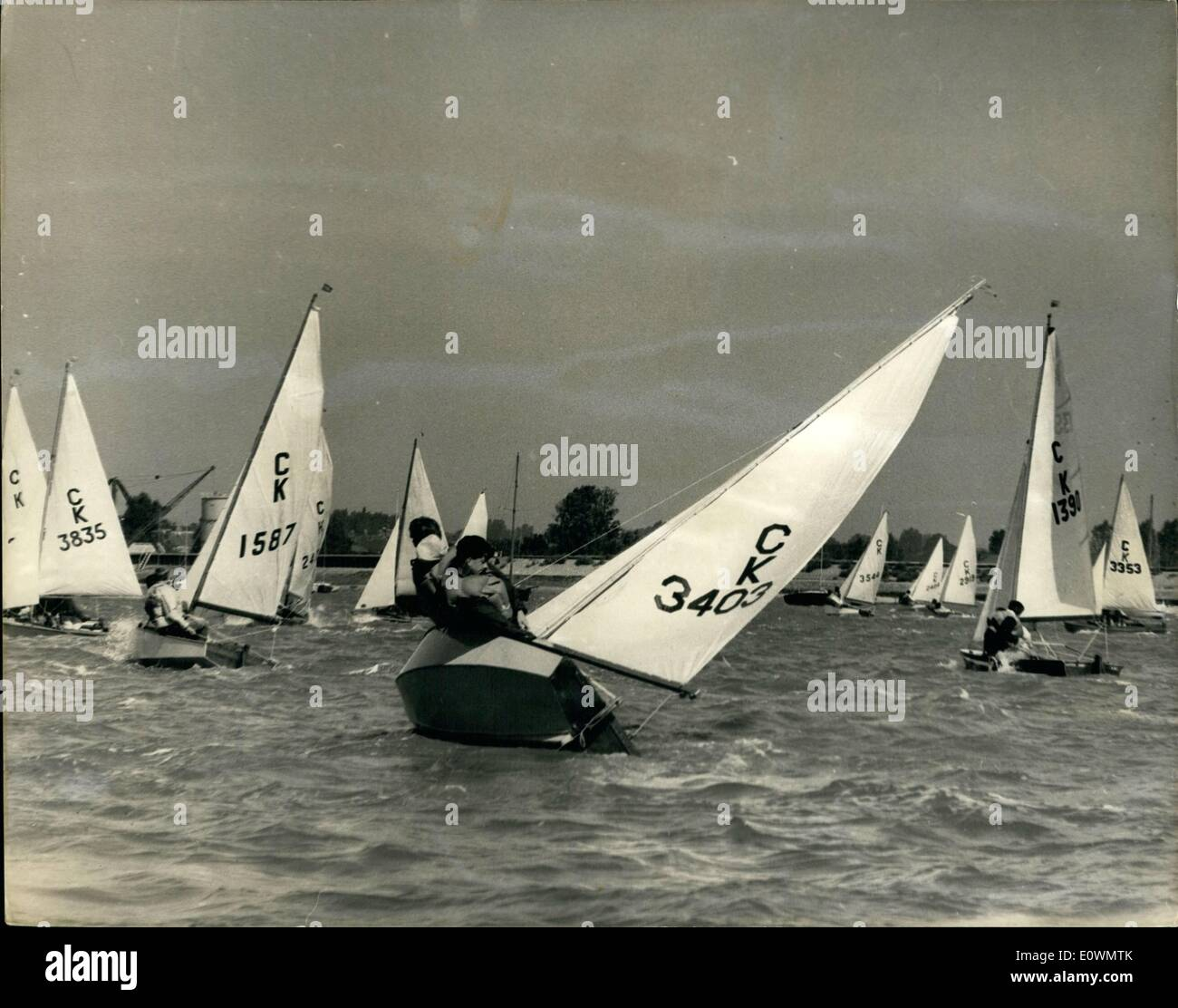 Aug. 08, 1963 - Cadet Week Opens: The fourteenth Annual International Cadet Class dinghy week of races opened today at Burnham-Crouch. The Cadets can only be sailed by persons under 19 years of age. Photo shows It's ''loan well out'' as the Cadet Class boats round a marker buoy during their race. - Stock Image