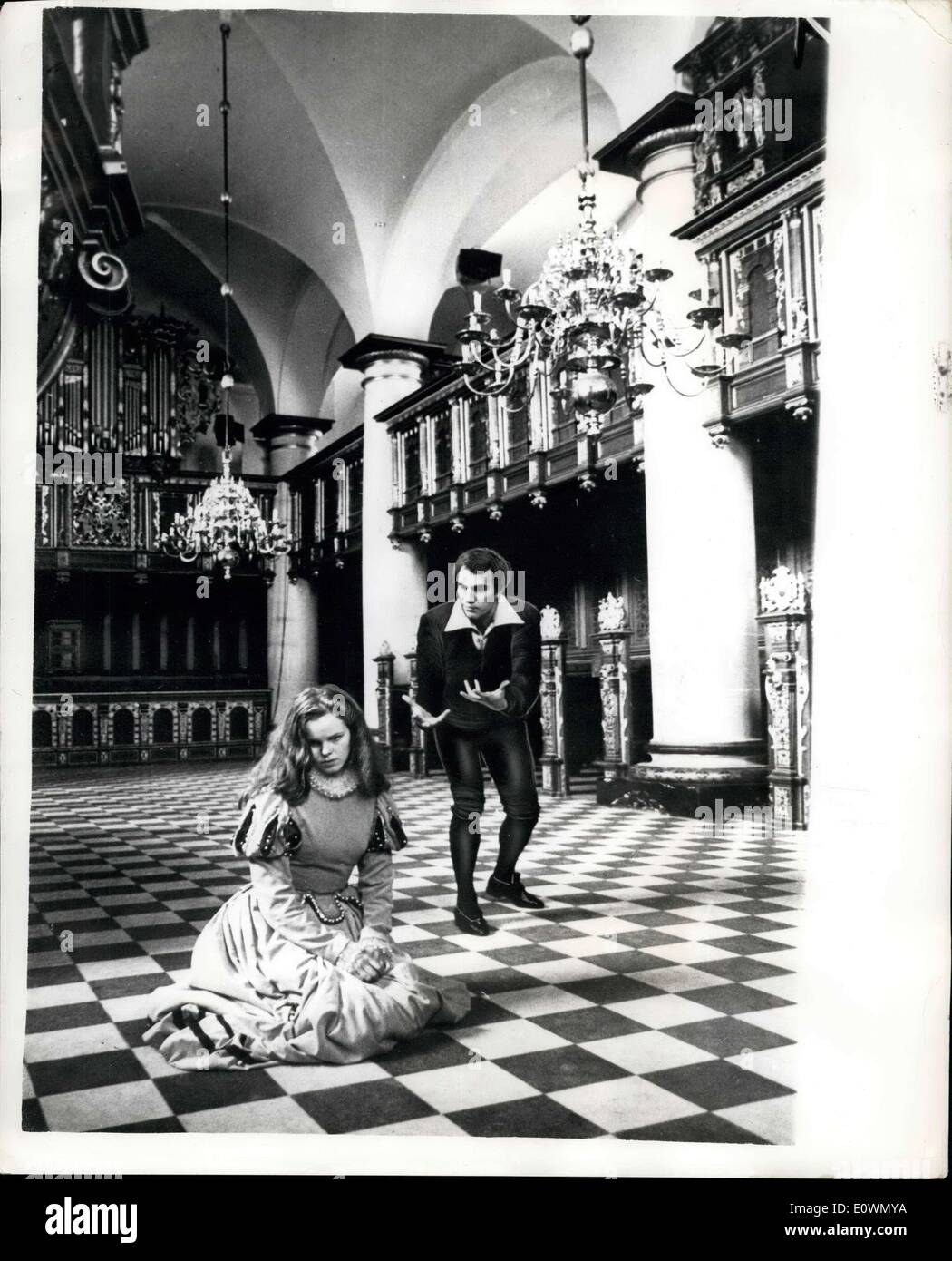 Sep. 23, 1963 - Filming of Hamlet is Complete: The filming of the combined Anglo-Danish television production of ''Hamlet'' which has been staged at the Kronborg Castle at Elsimore in Denmark which was the setting that Shakespeare gave to the play, is now complete after only 10days work, including rehearsals, which has meant that the 100 or so workers that have been involved in the production have had to work a fourteen hour day. Photo shows Hamlet (Christopher Plummer) and Ophelia (Jo Maxwell Muller) play their tragic love scene in the Royal Chapel of the Kronborg Castle at Elsinore. - Stock Image