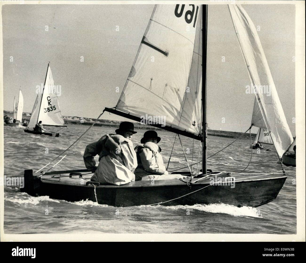 Aug. 19, 1963 - Cadet Week Opens - The Fourteenth International Cadet Class racing dingh week opened at Burnham-on-Crouch today. the Cadets can only be sailed by Persons uder 19 years of age. Photo Shows:- An Unusual Headgear in the form of bowler hats are worn by P. Sharp and D. Foreman of Whitstable, Kent, Seen During the Cadet Class Race. - Stock Image