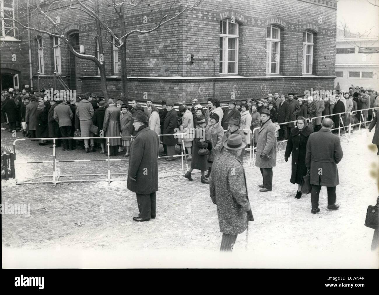 Dec. 12, 1963 - On Christmas: Passportsfor Westberliner to Eastberlin. Today (18.12.) in the early morning hours mant people comes to the points in the Westberlin school where they can get the passports to see their relations in Eastberlin. The passport points opened in the noon at 13.00 hours. OPS: Many people are waiting before the Breiteheid School in Berlin Tiergarten. Stock Photo