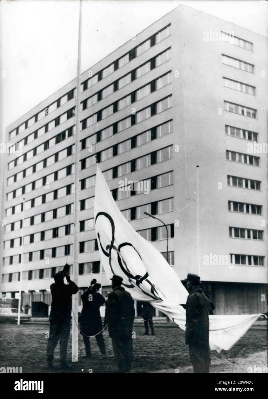 Jan. 01, 1964 - Official opened: Was on 15-1-64 the Olympic Village at Innsbruck. The Lord- Mayor of Innsbruck Dr Lugger presented the Key of the Olympic Village to professor Friedl Wolfgang, who is the General -Secretary of the Organization- Kommity and says in his speech, that he is hoping real sportive sense will rule in this village. Picture Shows: The Olympic Flag goes in the height in the Olympic village (at the top) and the over giving of the key. In the middle Dr - Stock Image