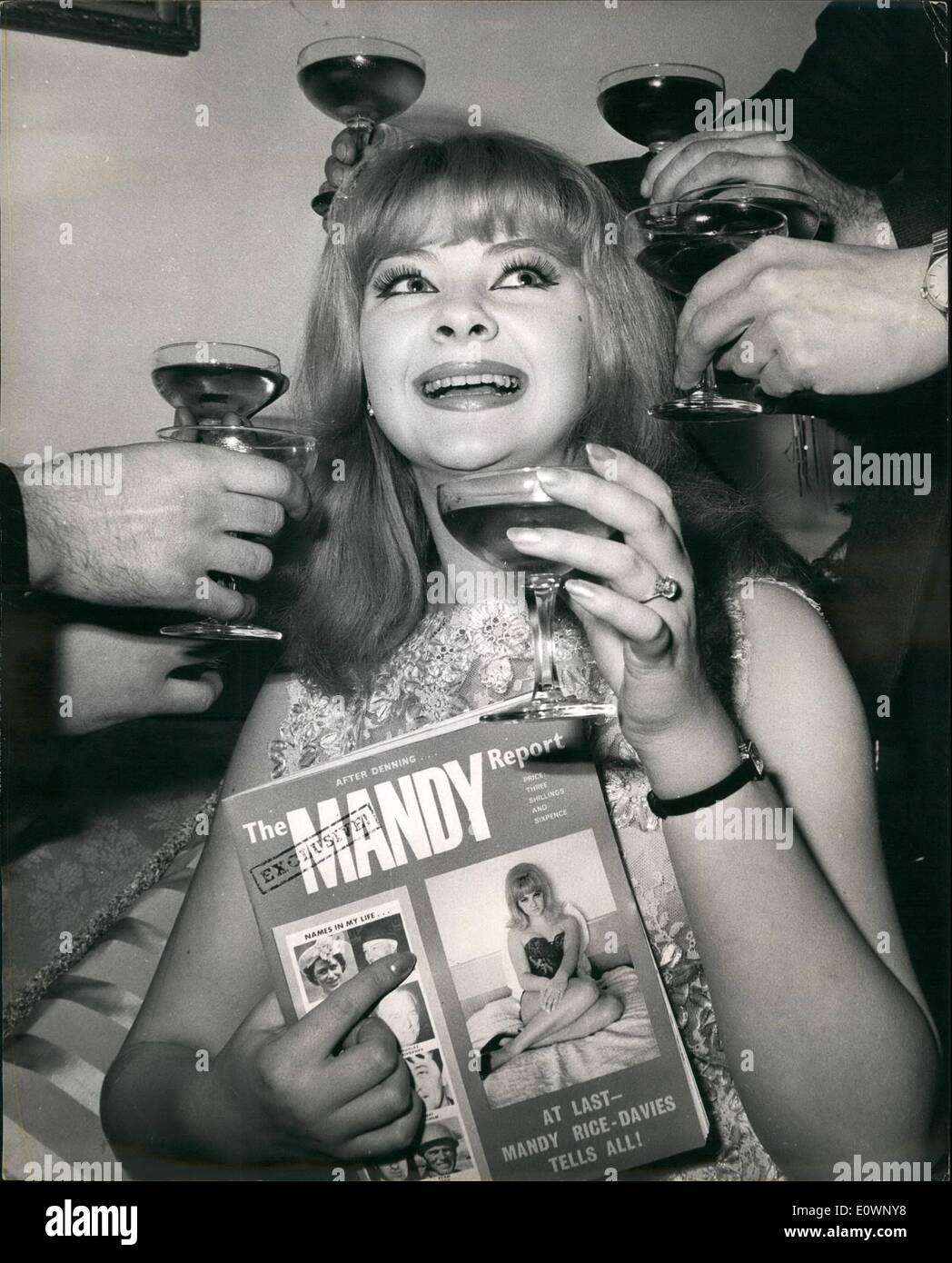 Jan. 01, 1964 - Mandy holds a party: To launch her book the ''Mandy Report'' which is published today, good time girl Mandy Rice - Davies held a party at her Kensington flat. The report gives her version of the Keeler - Profumo affair. Mandy said that she had invited Lord Astor, Lord Denning, Bob Hope and Douglas Fairbanks Jr. to the party, but only the press and her publishers turned up. Mandy was wearing the ring given to her by her former lover, property racketeer Peter Rachman who is now dead. Photo shows Mandy Rice-Davies at her party last night. - Stock Image