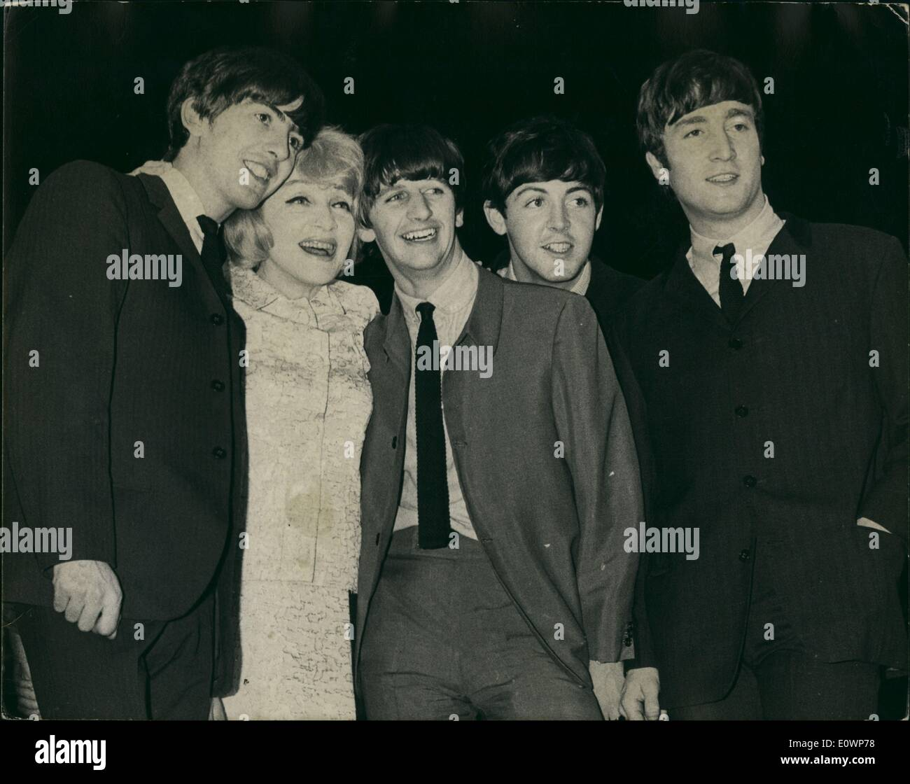 Nov. 11, 1963 - Marlene Dietrich Meet the Beatles.'' Famous German cabaret artist and film star Marlene Dietrich is seen with the popular singing group the Beatles when they were rehearsing for tonight's Royal Command Variety Performance which is to be held at the Prince of Wales Theatre in the presence of the Queen Mother tonight. - Stock Image