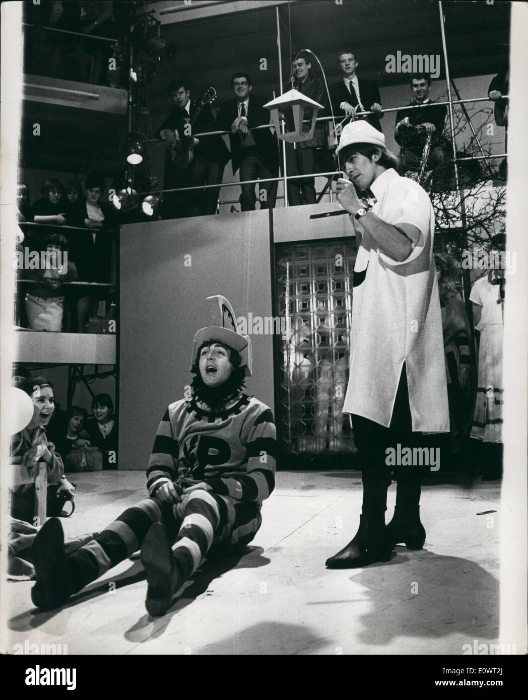 Apr. 04, 1964 - Beatles go Shakespearean : The Beatles are shortly to appear in a television show in which part of their performance will be an exerpt from ''A Midsummer Night's Dream'' by William Shakespeare. The results are enough to make Shakespeare''twist and shout'' in his grave. Photo shows Paul McCartney as ''Bottom'' sits on the stage while George Harrison as ''Moonshine'' stands over him. - Stock Image