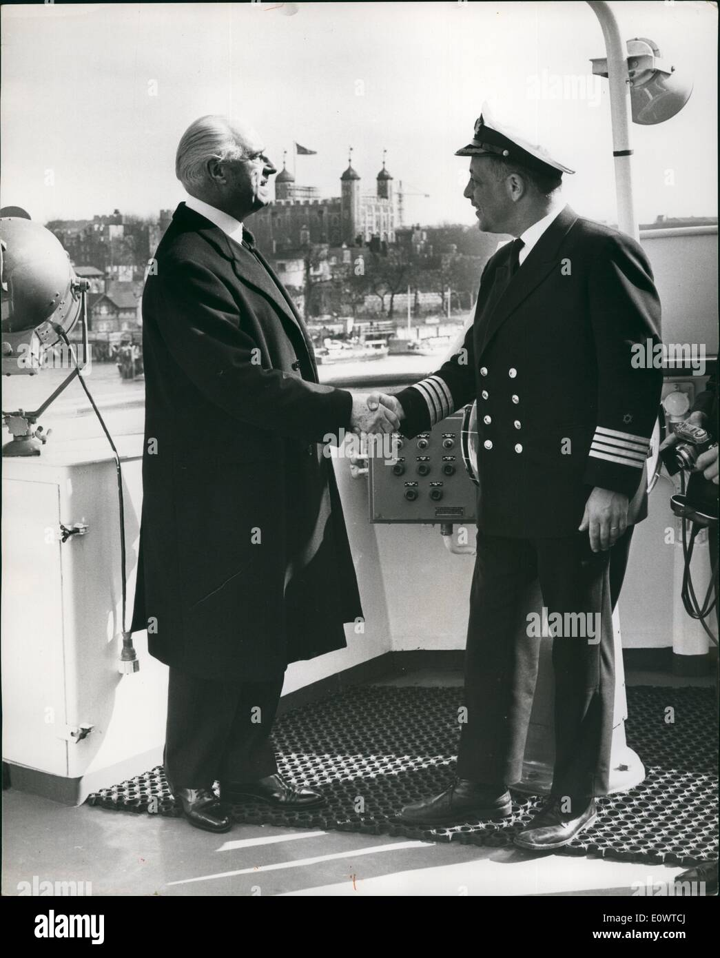 Mar. 03, 1964 - Lord Mayor of London visits Newship: The Lord Mayor of London, Alderman C.James Harman and the City Sheriffs,this morning paid a formal visit to the new 7,000 ton Israel car ferry m.v. Bilu which has come to London on it's maiden voyage from the Belgian builders in Antwerp. Bilu is to cruise in the Mediterranean before going into regular service between Italy and Israel. Photo shows The Lord Mayor shakes hands with Benjamin Yatir, the Captain of the Bilu this morning. In the background can be seen the Tower of London. - Stock Image
