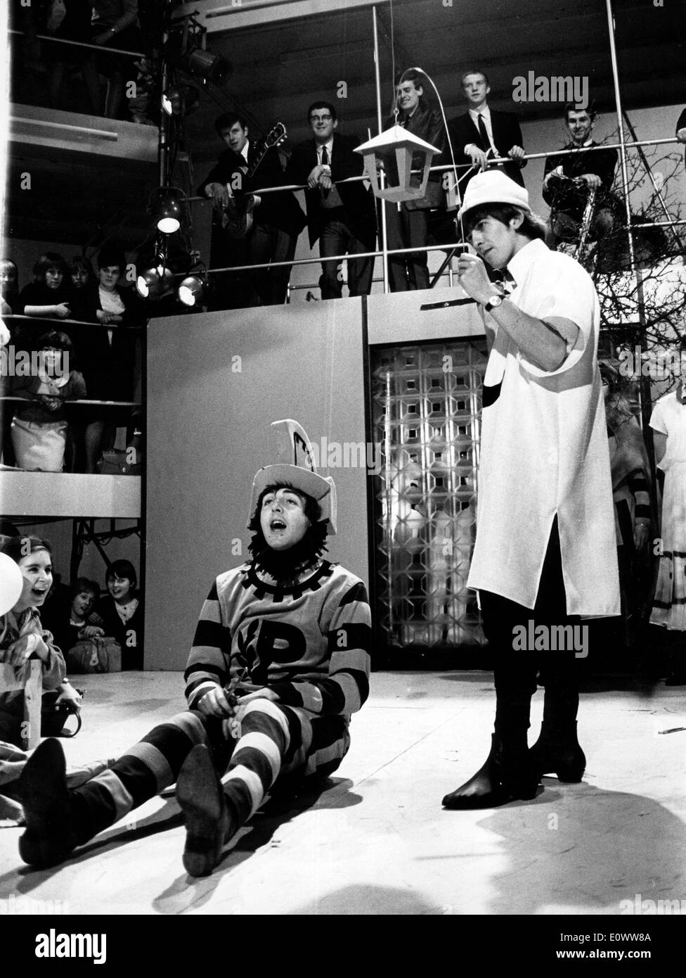 The Beatles Paul McCartney and George Harrison performing on a television show - Stock Image