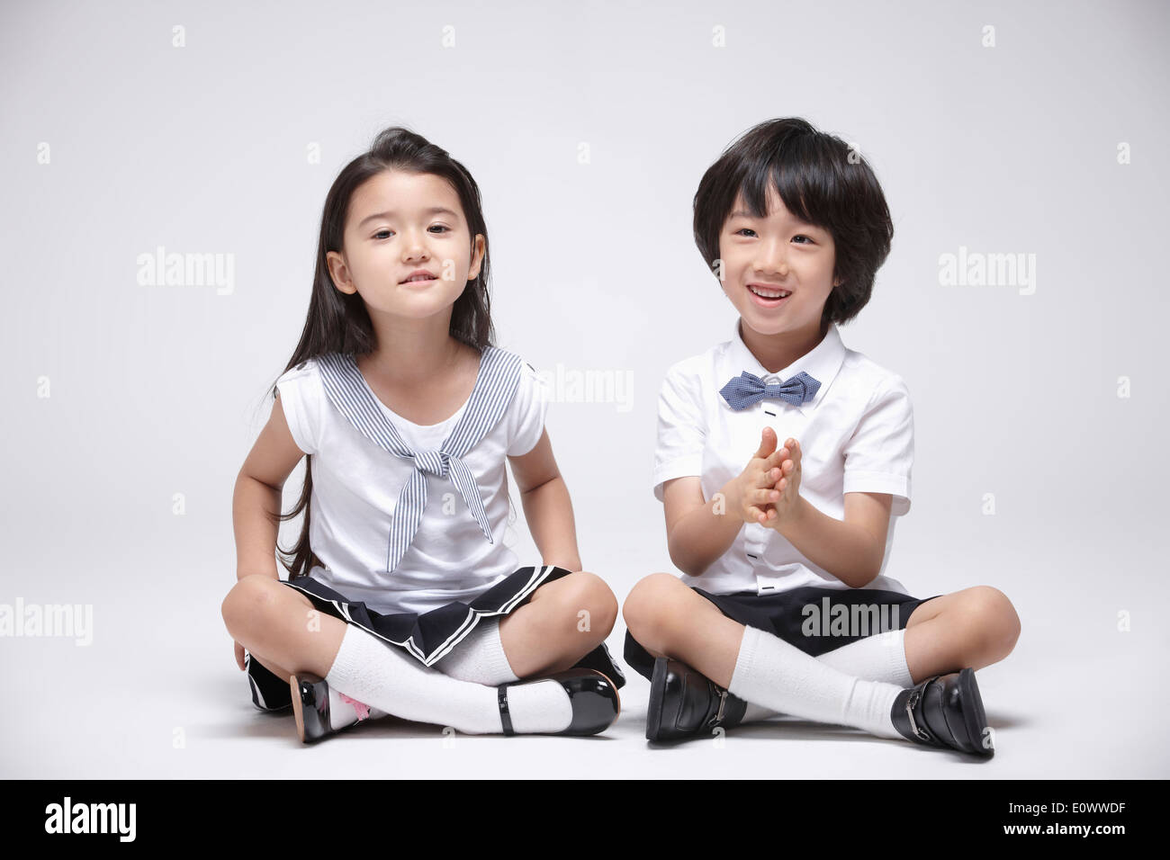 a boy and a girl sitting next to each other stock photo 69410251