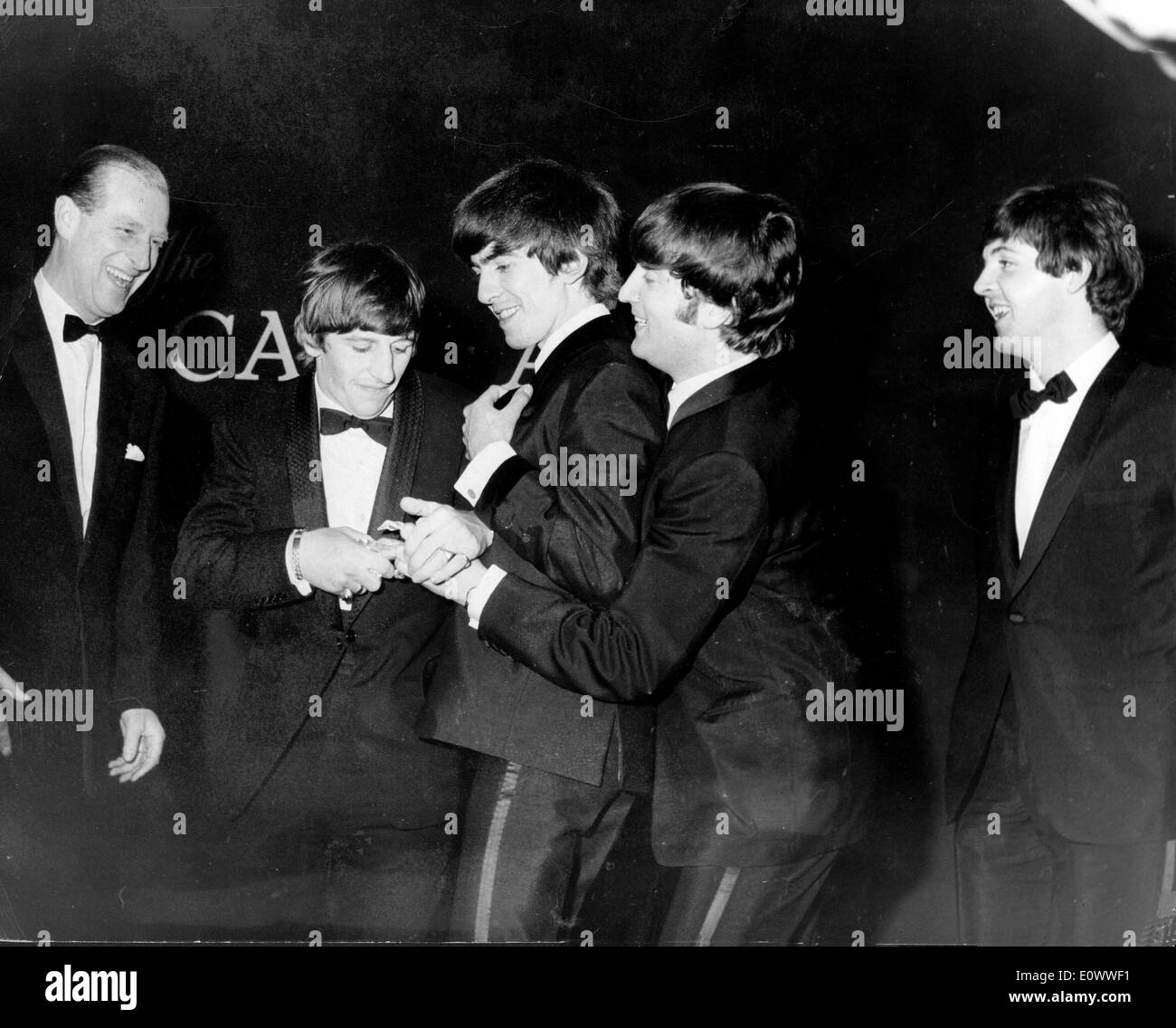 The Beatles jokingly fight over their Carl-Alan Award - Stock Image