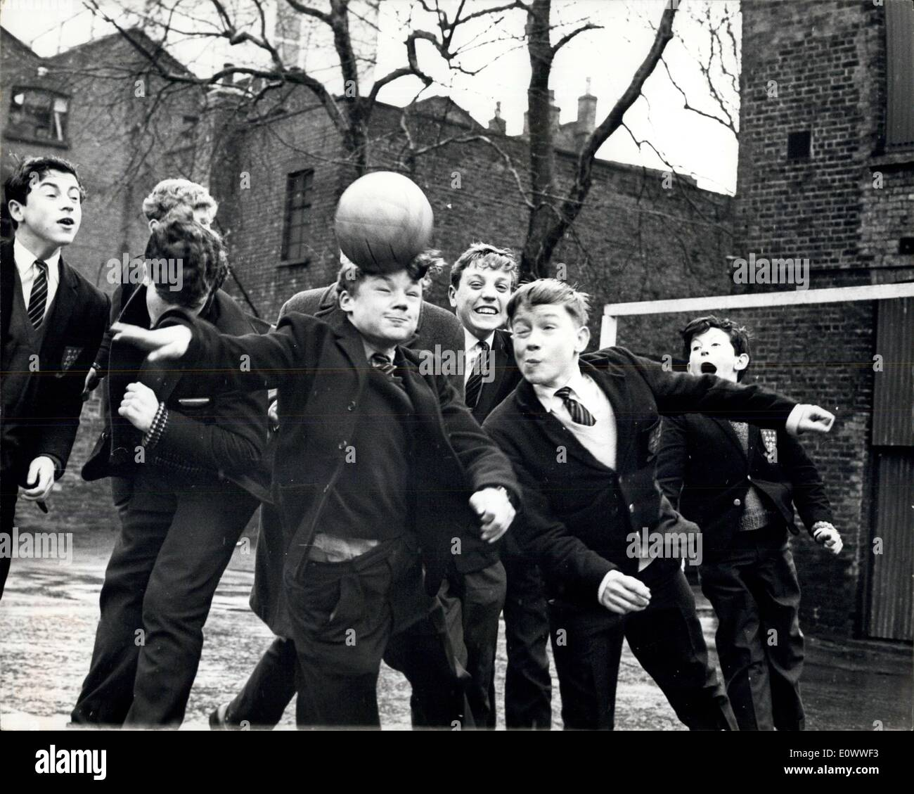 Mar. 25, 1964 - 13-Year Old Sign As Professional Footballers: Two boys milled around on the school playground at Davenant Foundation Grammar School in Stepney yesterday, making soccer history. For at 13, Terry Brisley and Dennis Rofe have been signed up by Leyton Orient, to become the youngest players ever to join a League club, after being spotted by a talent scout in a schoolboys cup final. Both weigh about seven stone, and with Terry 4 ft 7 1/2 ins and Dennis an inch taller, they are probably the smallest players ever to be signed - Stock Image
