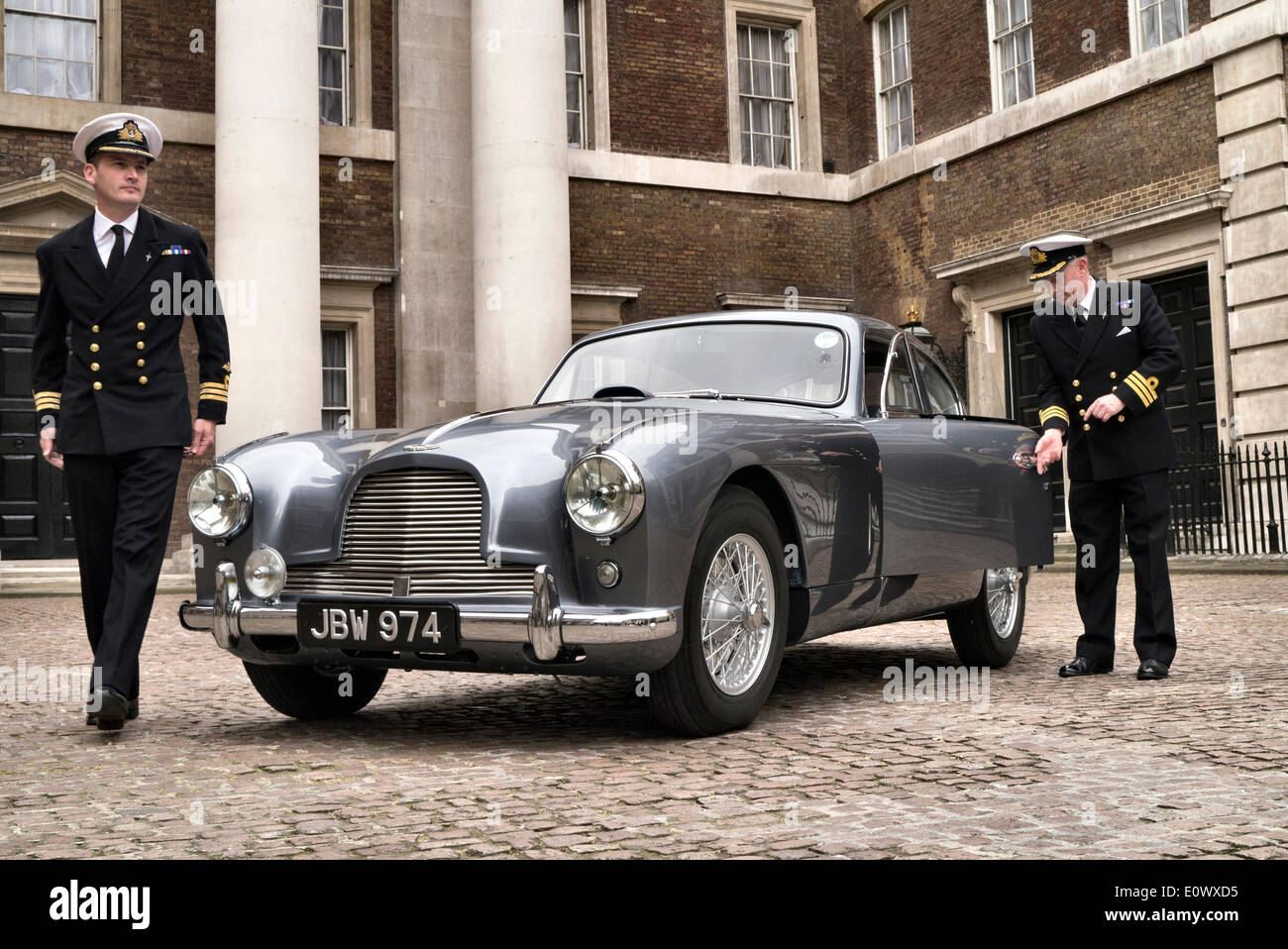 Whitehall, London, UK. 20th May 2014. 1954 Aston Martin DB2/4 thought to be the inspiration for Ian Fleming's Commander James Bond 007. Photographed in the Old Admirality Building in White Hall with two naval Commander's. Credit:  Martyn Goddard/Alamy Live News - Stock Image