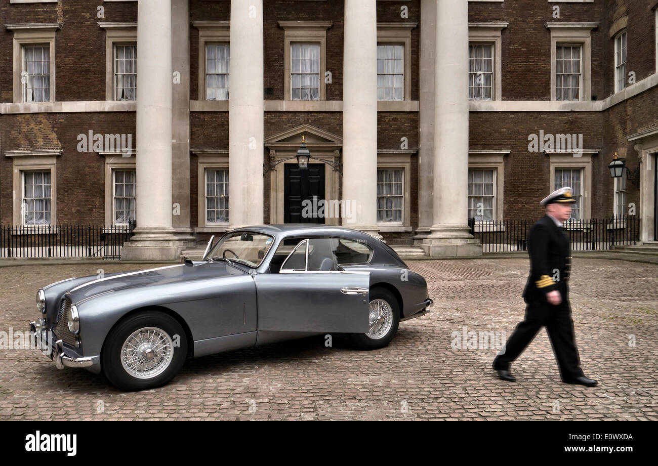 Whitehall, London, UK. 20th May 2014. 1954 Aston Martin DB2/4 thought to be the inspiration for Ian Fleming's Commander James Bond 007. Photographed in the Old Admiralty Building in White Hall with a naval Commander Credit:  Martyn Goddard/Alamy Live News - Stock Image