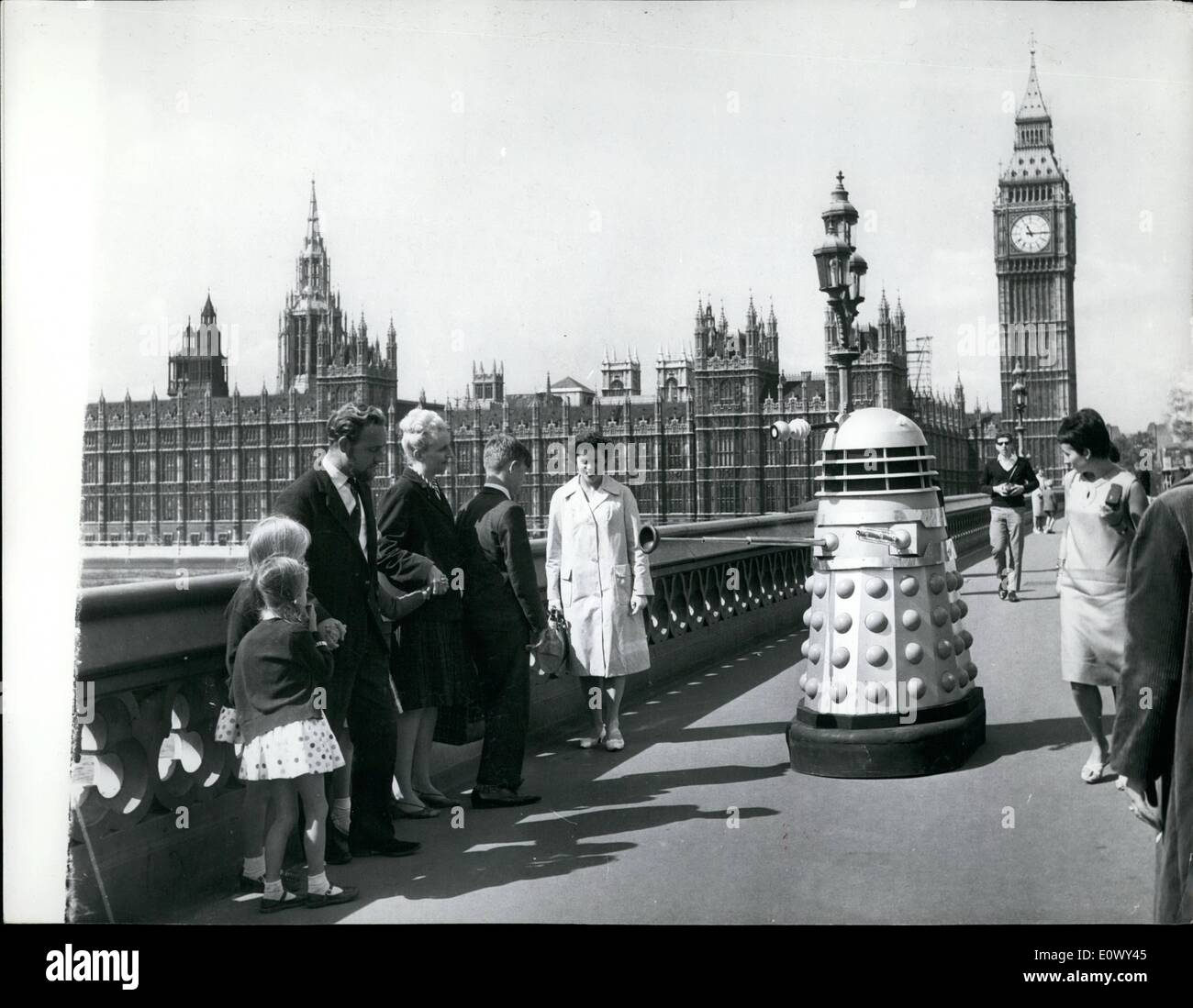 Aug. 08, 1964 - Location Hunting with the ''Daleks''. ''Landing on Westminster Bridge''.: To be seen on a tour of London this morning location hunting were the ''Daleks'' - those 'space' creatures for the new BBC TV series ''Dr. Who'' - which starts in November. Photo shows Passer-by wonder what is happening - as the ''Dalek'' - 'lands' on Westminster Bridge this morning. - Stock Image