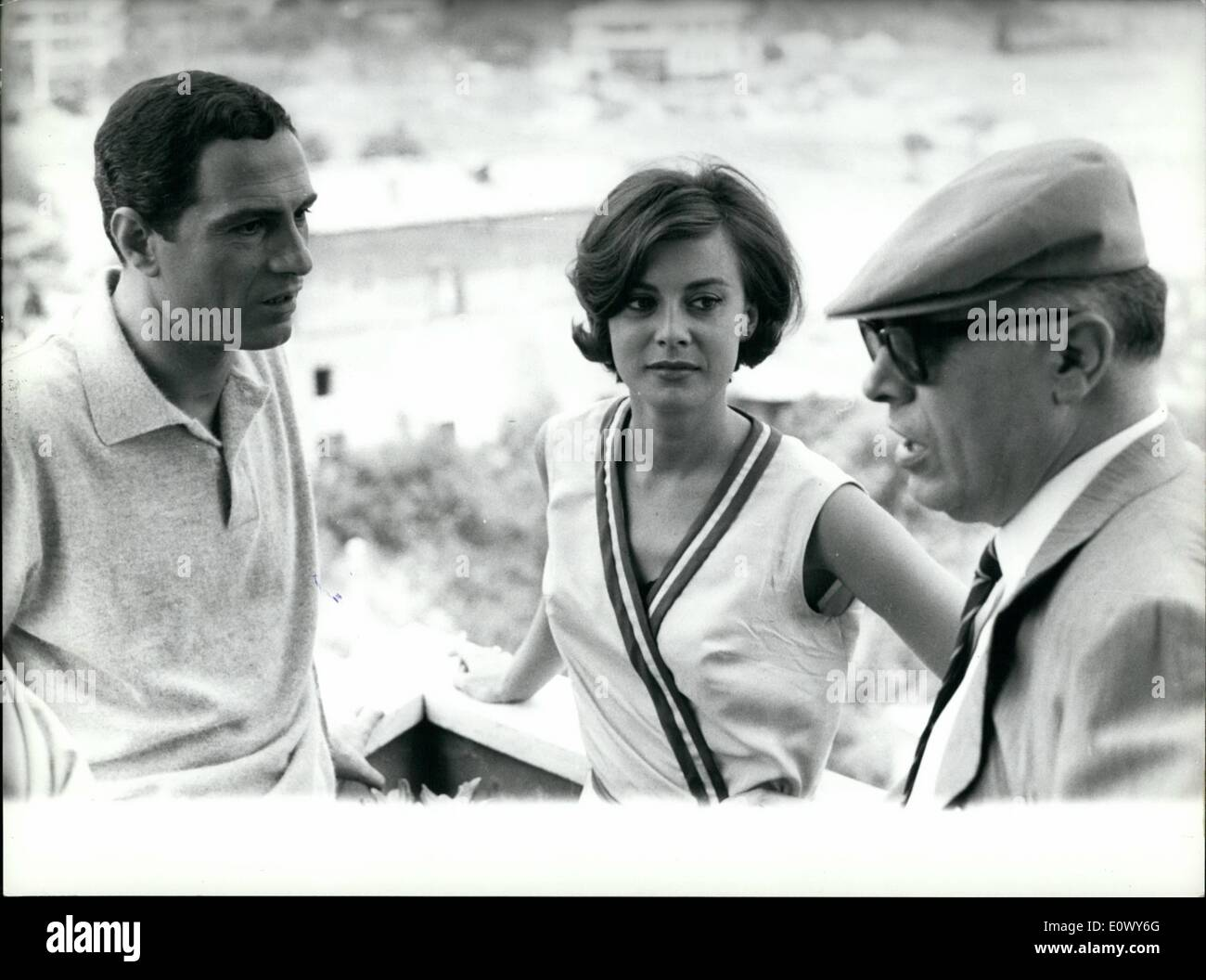 Jun. 06, 1964 - Anna Maria Ferrero the italian film star wife of French actor Jean Sorel is in Rome; for the first time since she married, the actress has began the shooting of a new film: a comic story ''Cocaine la dimanche'' with well-known italian comic actor Nino Manfredi. Photo shows producer Carlo Ponti Sofia Loren's husband visits Anna Maria Ferrero and Manfredi on the ''set'' of the film. - Stock Image