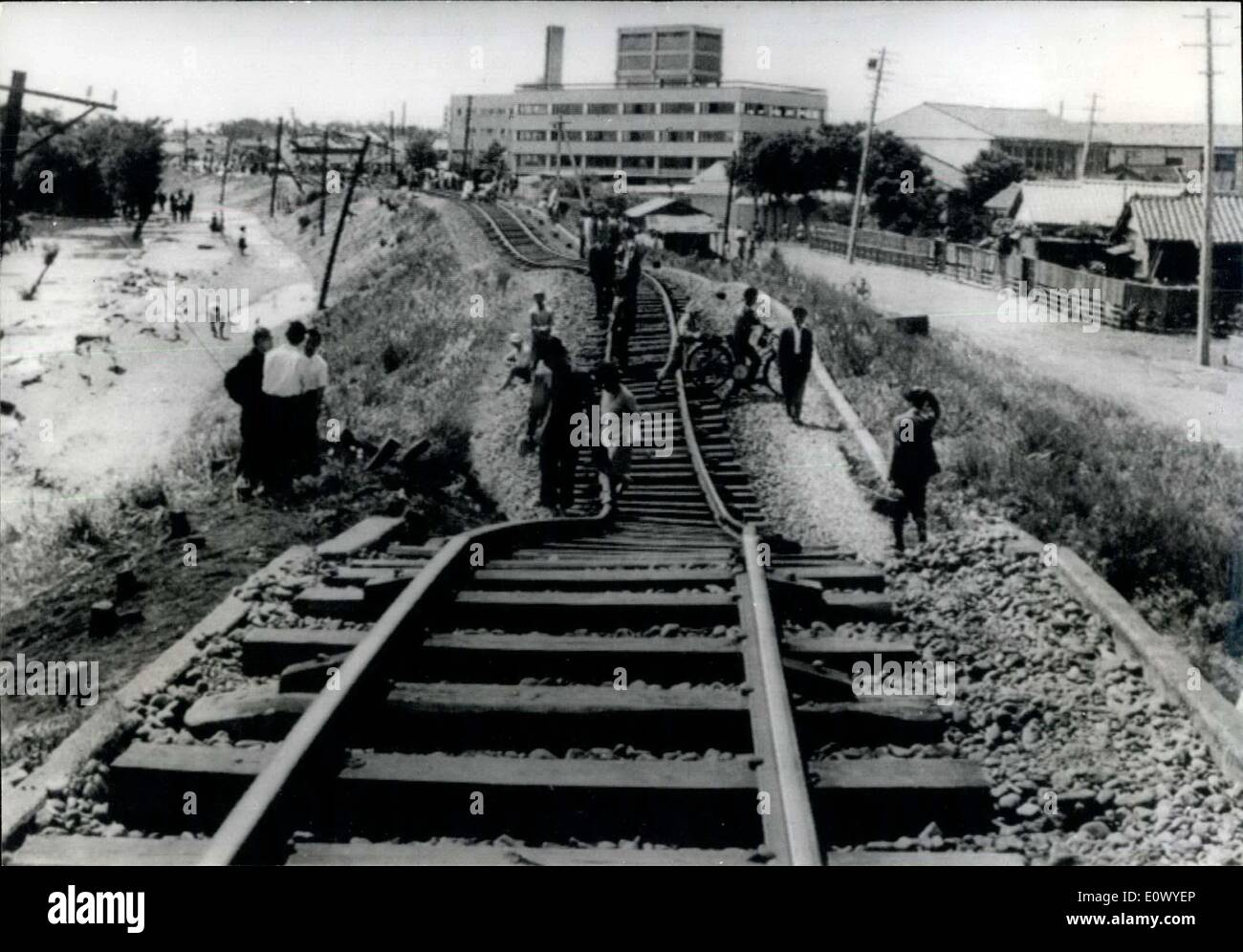 Jun. 16, 1964 - Earthquake disaster in Niigata Japan: The city of Niigata is a blazing shambles after the sever earthquake which took place at 1.02 PM 6/16/64, isolatig it from the rest of Japan as railway lines buckled, and the runway of the airport partly disappeared there is no water, electricity of sewerage remaining and thousand are homeless. The port of Niigata, one of the principal oil refining cities, suffered a double catastrophy as oil tanks burst spreading blazing oil over hundreds of houses nearby, destroying 291 of them - Stock Image