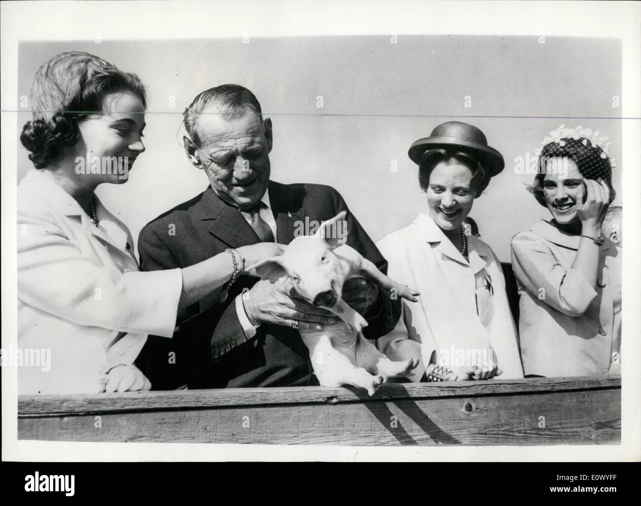 Jun. 23, 1964 - 23-6-64 This little piggy met the King. King Frederik of Denmark accompanied by Queen Ingrid and their daughters the Princesses Margrethe, Benedikte and Anne-Marie paid a visit to the Cattle Show at Bellahoej in Copenhagen over the weekend, where they saw the latest developments in Danish agriculture and machinery. Photo Shows: King Frederik is introduced to a little piglet at the Agricultural Show, watched by (left to right) Princess Benedikte, and Princesses Margrethe and Anne-Marie who were obviously highly amuse about the whole affair. - Stock Image