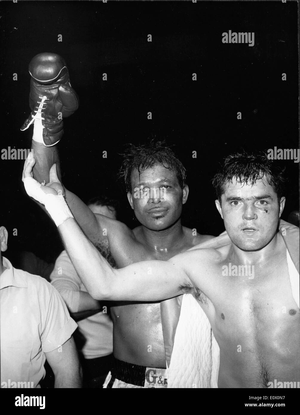 Sugar Ray Robinson with French opponent Yoland Leveque after beating him - Stock Image