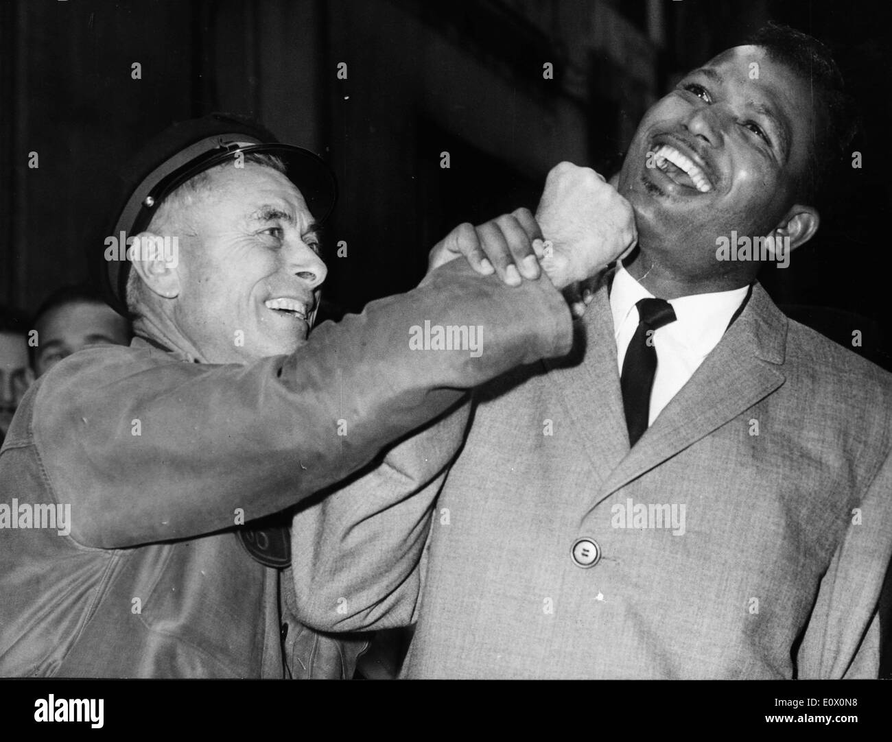 Boxer 'Sugar' Ray Robinson joking around with a fan - Stock Image