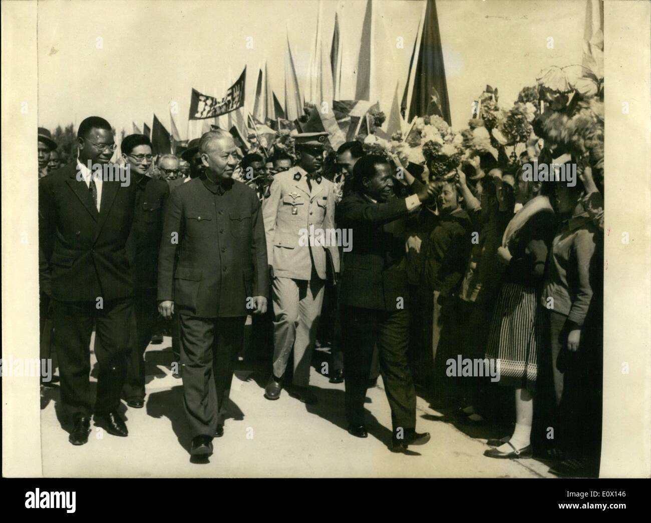 Oct. 10, 1964 - Enclosed find pix of Chinese-Congolese amity, and of anti-imperialistic demonstrations in Brazzaville. Photo shows President of the Republic of Congo, Alphonse Massamba-Debat (at right) being received at the airport of Pekin by President Liu Shao Chi (at left) - Stock Image