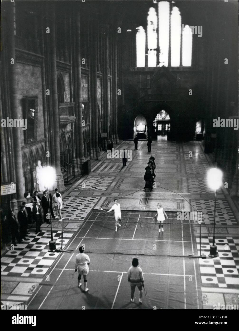 Oct. 10, 1964 - An Adjournment - at the Royal Courts of Justice in the London.: The Royal Courts of Justice in the Strand take life very much as it comes. Whether it be a bitter divorce case or the tangled complexities of Chancery and Probate, of Admiralty and Appeal. These are its normal and historic pursuits, protected by jealous dignity and proud tradition. But at night, when the judges have gone and counsel have returned safe to the rules of badminton. The Supreme Court of Judicature moves out, and twice a week the Supreme Court Badminton Club moves in - Stock Image
