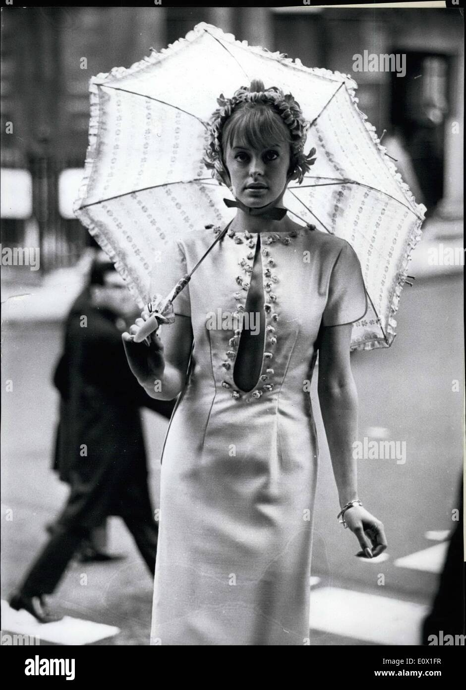 Dec. 12, 1964 - She looks nicer. because she has reversed her dress.. Eyes popped when Gay Beresford stepped out - Stock Image