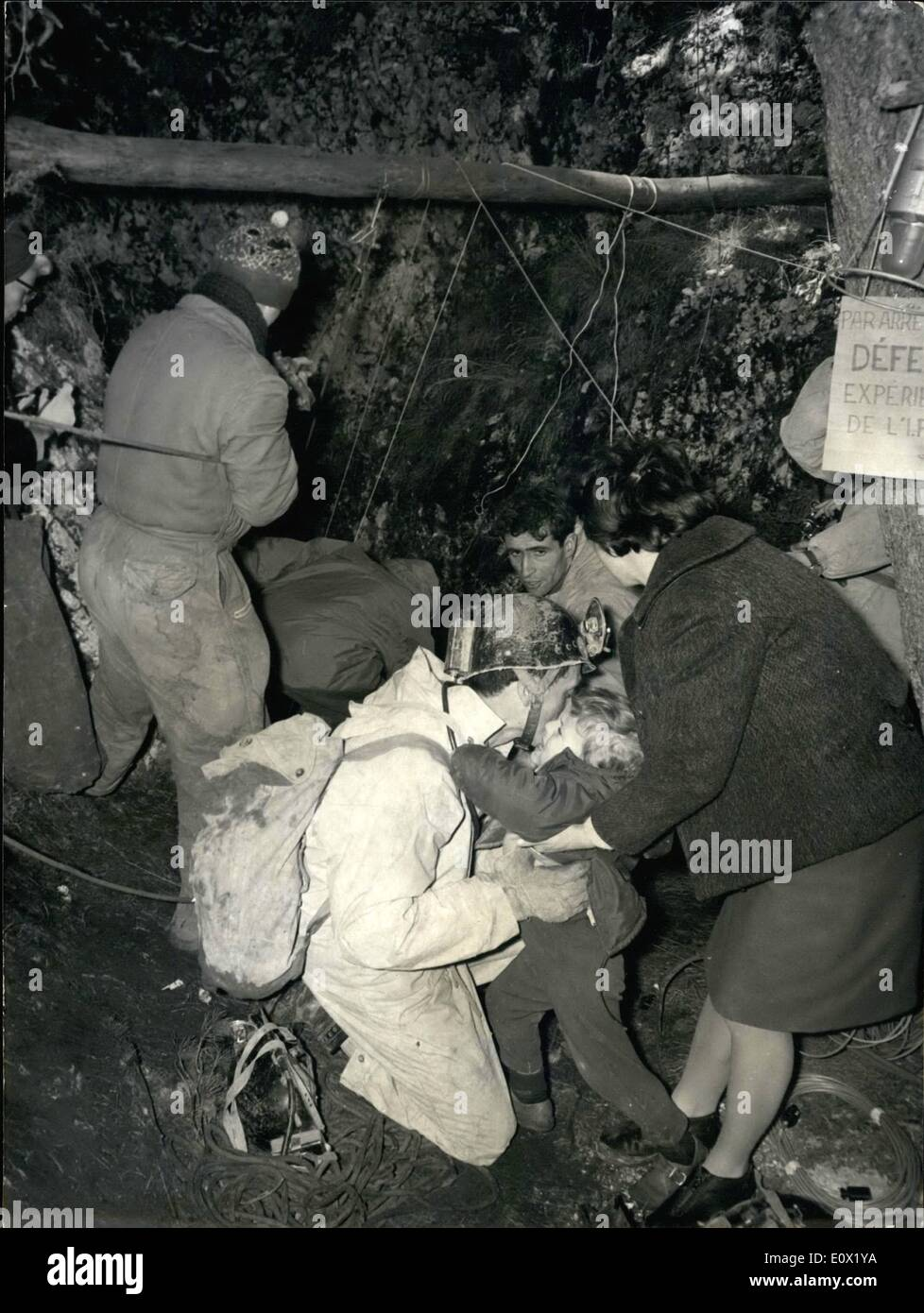 Dec. 12, 1964 - Operation ''Survival'': Cave explorers to say four months underground: Two cave explorers, a man, Antoine Senni, and a woman, Josy Laures will stay four months at 1oo meters below the ground to test the conditions of survival deep underground, the cave is located in a mountain range near Grasse,Souther France. Photo shows Antoine Senni holding his son Herve in his arms prior to starting the scent underground. His wife is next to him. - Stock Image