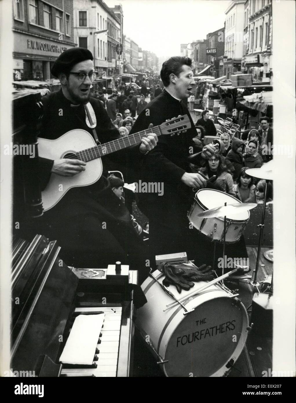 Dec. 12, 1964 - The Four fathers Entertain Christmas shoppers with Beat Versions of Carols at Hoxton Market. Four Anglican clergymen today played beat versions of religious music and carols to entertain Christmas Shoppers at Horton Market, London. The group, who call themselves ''The Fourfathers'' play their music from a lorry while parishioners collect for charity. The leader is the Rev. Kenneth Loveless, 53 year old Rural Dean of Shoreditch, plays concertina; Father Jeremy Hutchinson, 32, Vicar of St - Stock Image