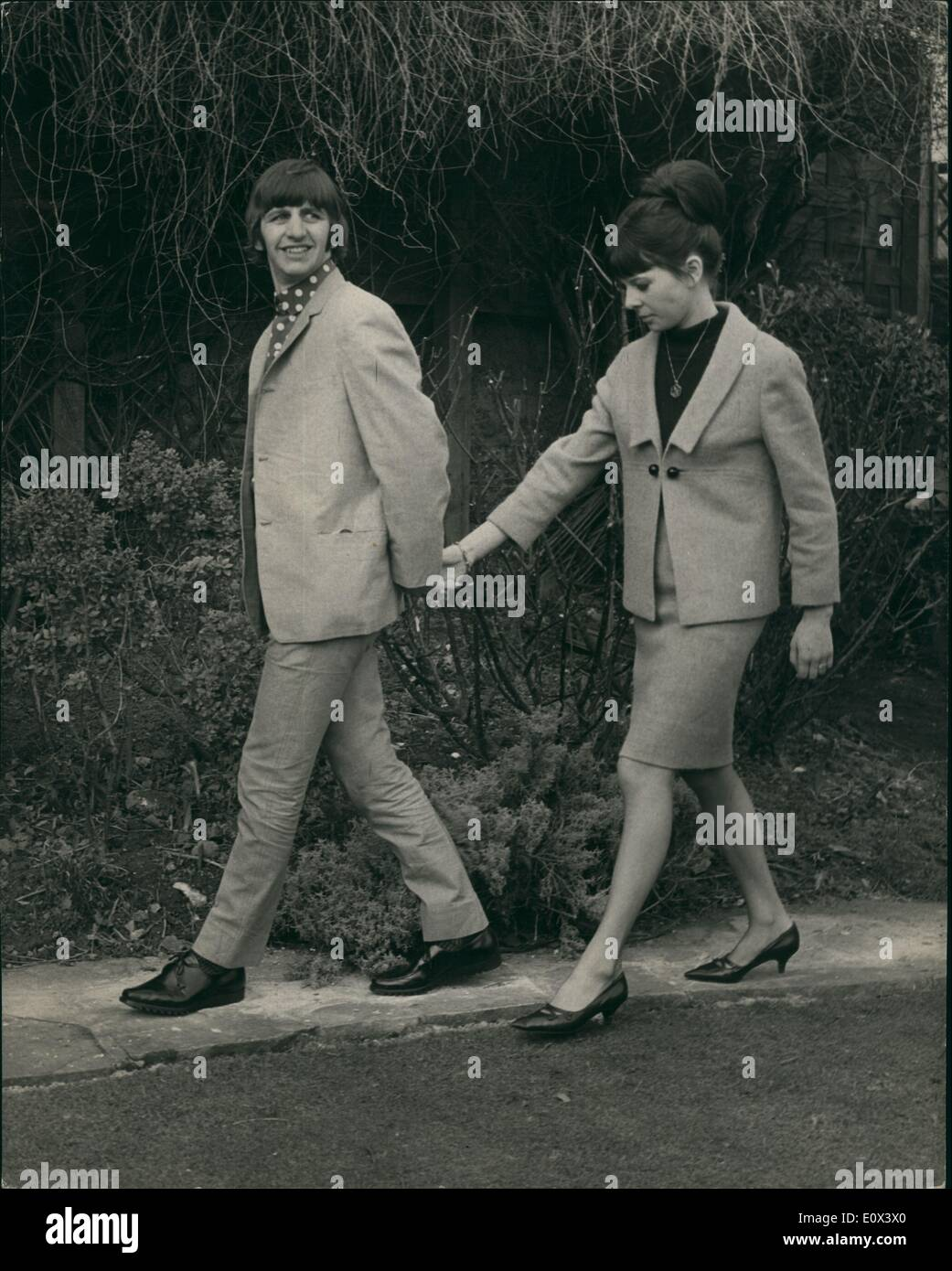 Feb. 02, 1965 - Ringo And His Bride - Meet The Press ''Secret'' Hideout - At Brighton: Ringo Starr of The Beatles - and his bride of 24 Hours Mary Cox - met besigned by members of the press today - at the house in Hove, Sussex - which was supposed to be their secret Wedding hideout. The couple were married at 8-15 yesterday morning at London's Caxto Hall. Photo shows Richard Starket (Ringo Starr) and his beside - at the house in Brighton this afternoon. - Stock Image