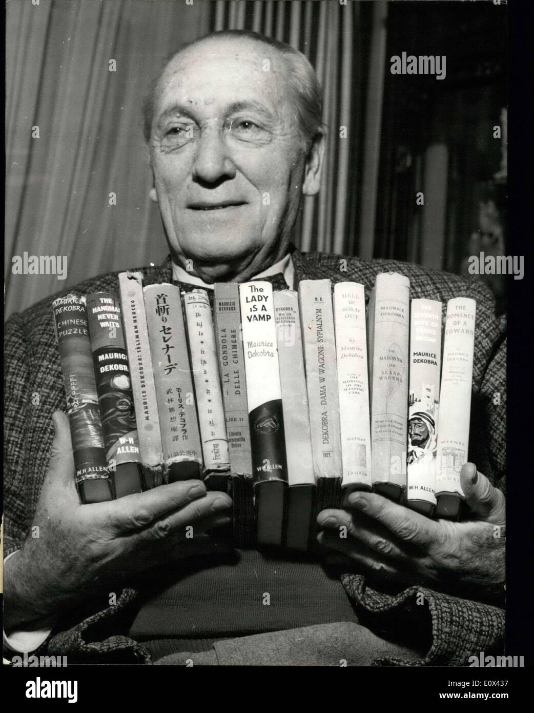 Mar. 18, 1965 - Maurice Dekobra Beats a record: 90 Novels Translated into Twenty Languages. Maurice Dekobra, the famous French Novelist, has set up a record: His 90th Novel has just benl Released and his books have been translated into Twenty :Languages, Chinese and Hebrew included. Picture shows: Maurice Dekobra holding some of his books. - Stock Image
