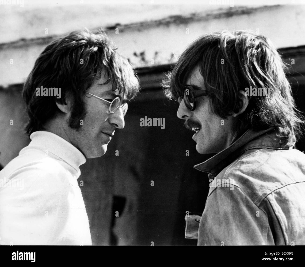 The Beatles John Lennon and George Harrison talking to each other - Stock Image