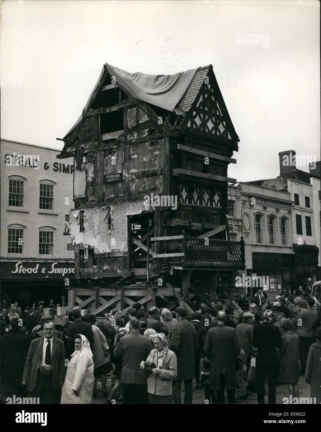 May 05, 1965 - Historis 17th. Century Building is removed on one piece to a Temporary site in Hereford: After six years of negotiations with the Hereford City Council a 17th, century four-storey building was saved from being demolished to make room for the building of a chain store. Today it was jacked up 4 feet from it's foundations and transported on a trolley vehicle down the High Street to a temporary site alongside the City's historical Town House. In six months time it will be brought back to be incorporated in the chain store - Stock Image