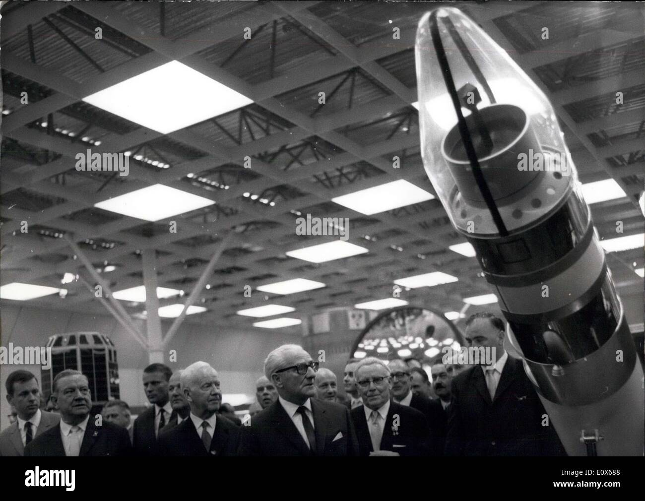 Jun. 25, 1965 - First World Exhibition of Transport and Communications ( 25.6 - 3.10.65): On June 25th, 1965 the First World Exhibition of Transport and Communications was opened by President Luenke in Munich. Photo shows The Bavarian President Goppel (left) and President Luebke with representatives of the Governments of the Federal Republic and of Bavaria and representatives of the Governments of the Federal Republic and of Bavaria and representatives of the economy looking for a model of rocket. - Stock Image