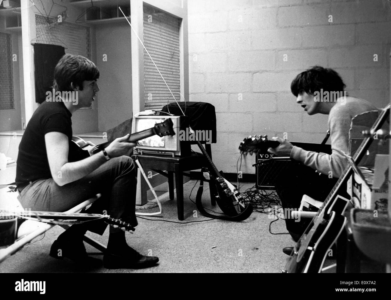 The Beatles Paul McCartney and George Harrison practicing - Stock Image