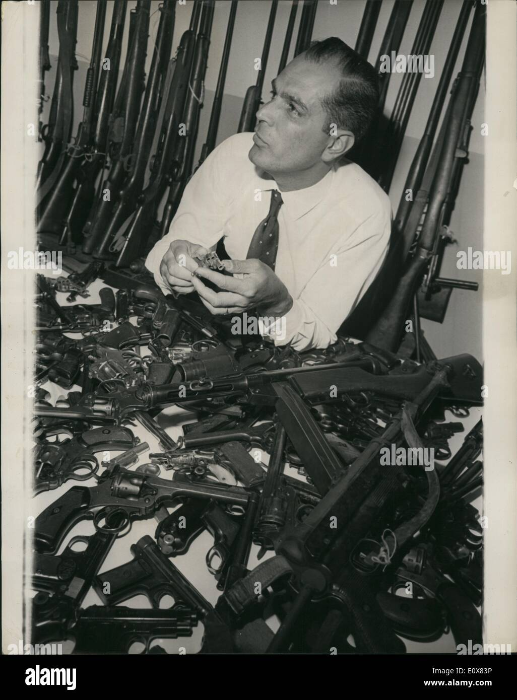 Aug. 08, 1965 - 400 guns in Amnesty armoury: All sorts of weapons were piled high on a table in a London office yesterday just part of a haul of firearms handed in to the police throughout Britain. In London alone 449 weapons have been surrendered since the firearm amnesty a week ago. When the amnesty ends in October, people illegally holding firearms will face heavier fines or a jail sentence. Even so, experts at the Metropolitan Police firearms department do not expect the total national haul to excessd 3,000 guns. Scotland Yard's chief firearms officers, Mr - Stock Image