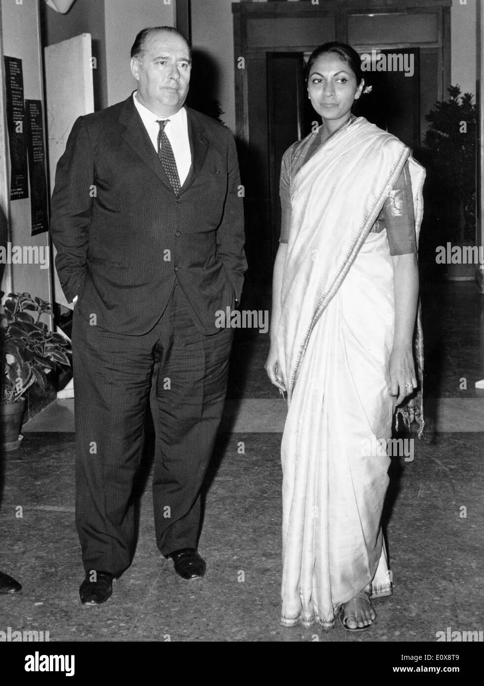 Director Roberto Rossellini with wife Sonali Das Gupta at a party - Stock Image