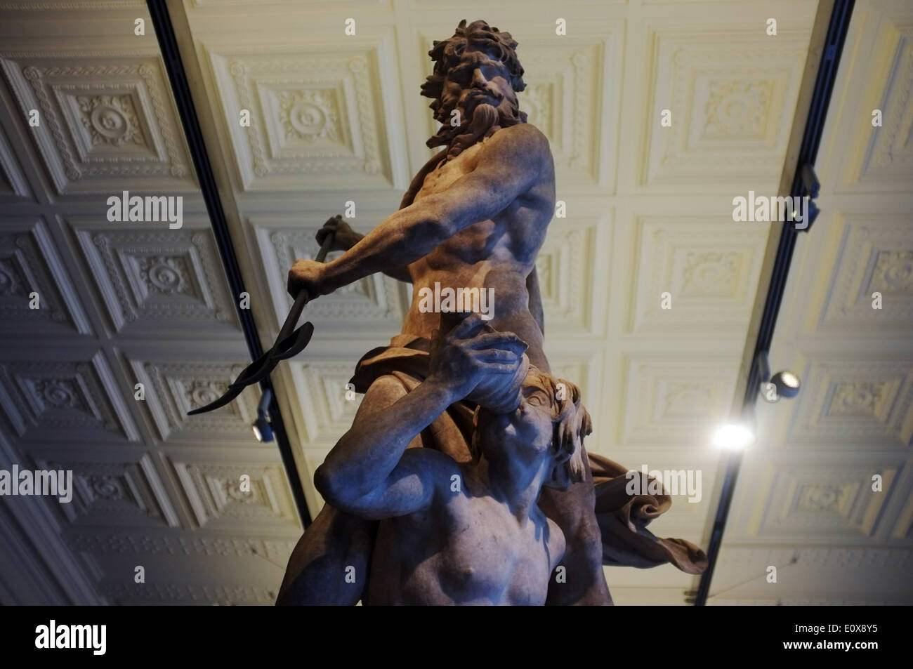 Poseidon sculpture and Greed/Lust/Envy drinking wine below him. Displayed at the VnA in London - Stock Image