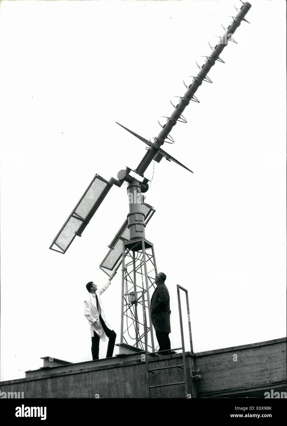 Dec. 12, 1965 - No Anti-Aircraft-Defence-Cannon: is this new super-antenna on the roof of the Offenbach weather-service. Although its name sounds very warlike, shall the meteorological-gun serve peaceable purposes. The wire-gun is an important implement for a more certain and quicker weather forecast. The German Weather Service in Offenbach makes big preparations, in order to comply with this task. At the begin of the new year will the Americans start a new weather-satellite ''TOS'' and at the same time will this meteorological gun get into action - Stock Image