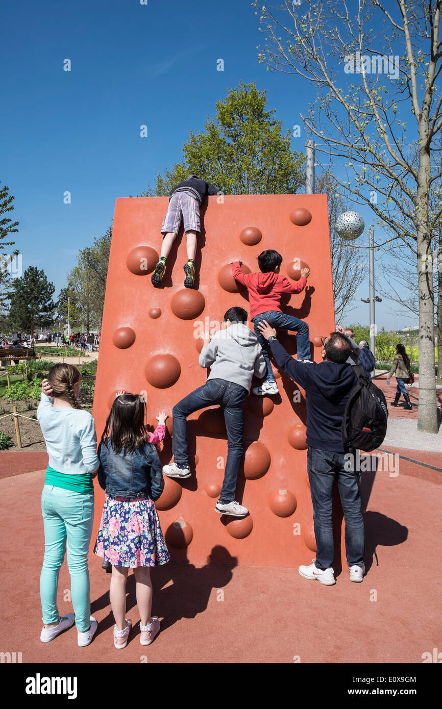 Busy playground at new Queen Elizabeth Olympic Park in Stratford London United Kingdom - Stock Image