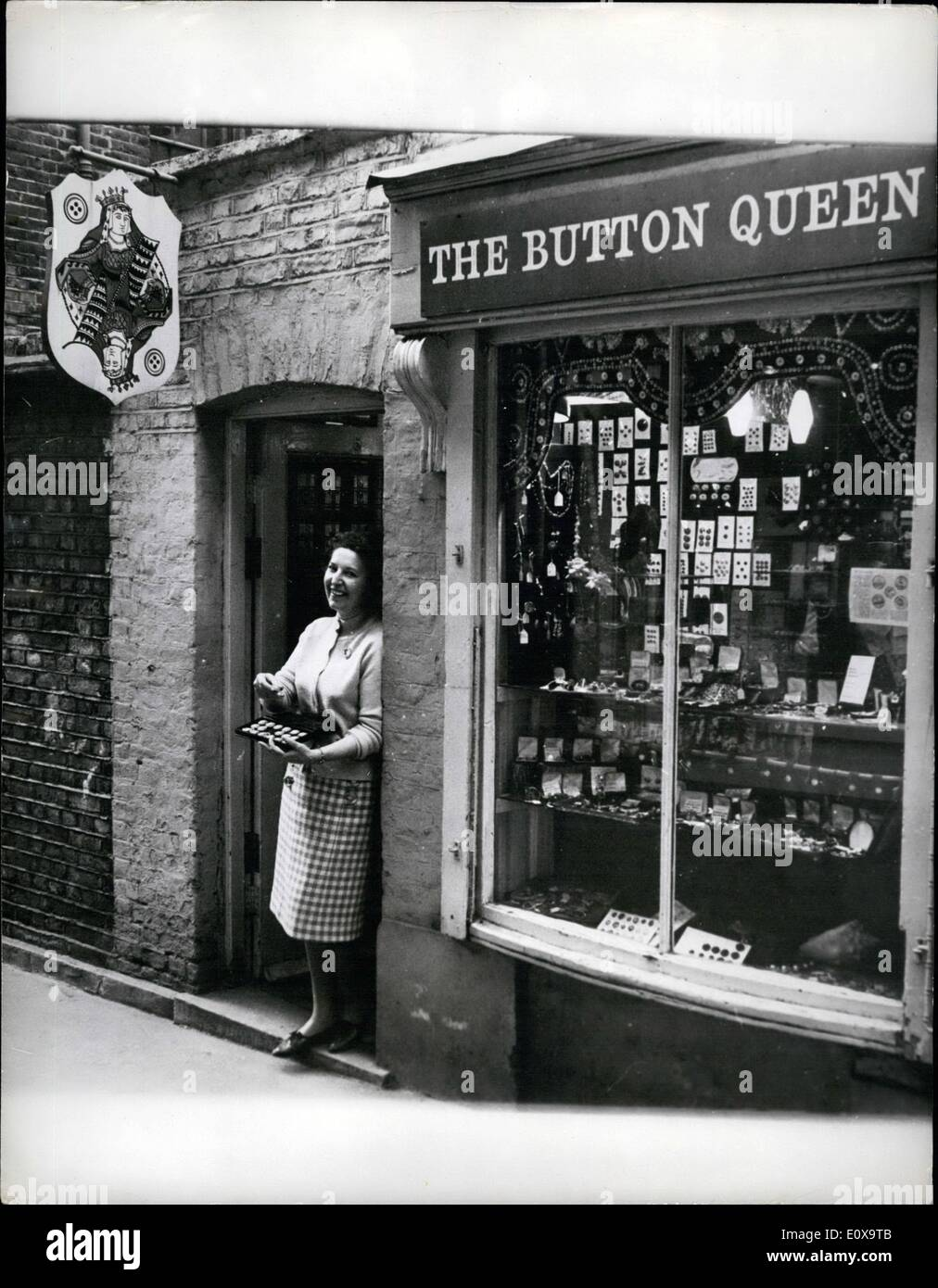 Oct. 10, 1965 - The Button Queen: Buttons, those vital parts of one's clothing, are rapidly taking their place along side stamps and coins as valuable collector's items. They are also helping the export drive 80 per cent of all antique buttons sold in Britain go to America, where button collection is second only to philately. In London, MRS. Toni Frith, whose 14-year association with buttons has earned the name 'The Button Queen', has graduated from a stall in the famous Portobello Road, to a comfortable shop in Marlborough Court off Carnaby-street, Westminster. Photo shows Mrs - Stock Image